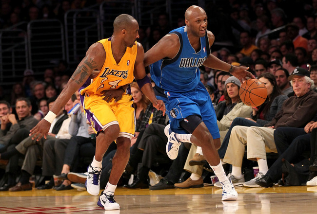 LOS ANGELES, CA - JANUARY 16: Lamar Odom #7 of the Dallas Mavericks drives down the court against Kobe Bryant #24 of the Los Angeles Lakers at Staples Center on January 16, 2012 in Los Angeles, California. The Lakers won 73-70.  NOTE TO USER: User expressly acknowledges and agrees that, by downloading and or using this photograph, User is consenting to the terms and conditions of the Getty Images License Agreement.  (Photo by Stephen Dunn/Getty Images)