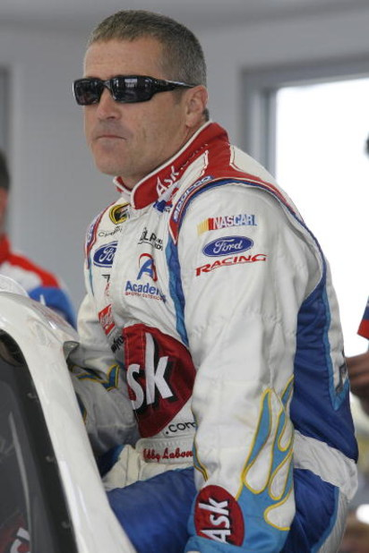 LAS VEGAS - FEBRUARY 27:  Bobby Labonte driver of the #96 ASK.com Ford climbs into his car before practice for the NASCAR Sprint Cup Series Shelby 427 at the Las Vegas Motor Speedway on February 27, 2009 in Las Vegas, Nevada.  (Photo by John Harrelson/Get