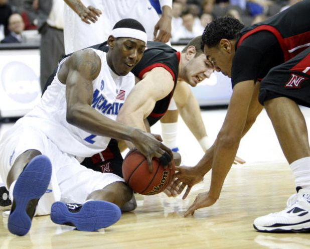 KANSAS CITY, MO - MARCH 19:  Robert Dozier #2 of the Memphis Tigers vies for a loose ball with Willie Galick #14 and Tremaine Townsend #33 of the CSUN Matadors in the first half during the first round of the NCAA Division I Men's Basketball Tournament at