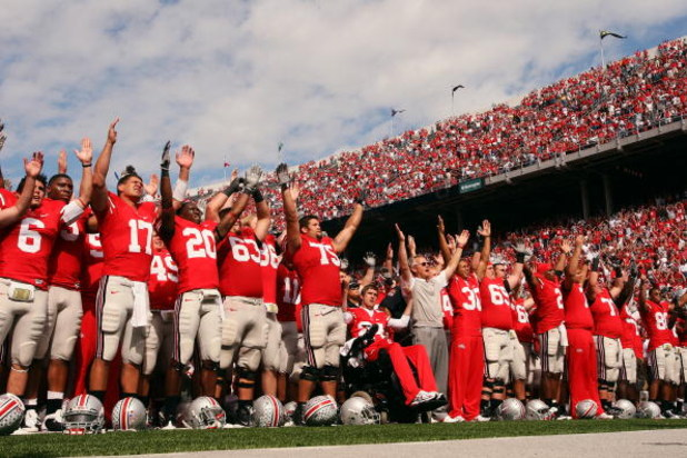 COLUMBUS, OH - SEPTEMBER 27:  Ohio State Buckeyes' head coach Jim Tressel leads his team in the singing of the school's alma mater, Carmen Ohio, after the Buckeyes defeated the Minnesota Golden Gophers 34-21 on September 27, 2008 at Ohio Stadium in Columb