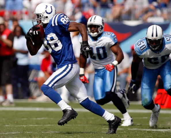 NASHVILLE, TN - SEPTEMBER 16:  Marvin Harrison #88 of the Indianapolis Colts avoids a tackle by David Thornton #50 of the Tennessee Titans on September 16, 2007 at LP Field in Nashville, Tennessee.  The Colts defeated the Titans 22-20.   (Photo by Chris G
