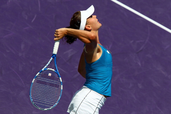 KEY BISCAYNE, FL - MARCH 30:  Agnieszka Radwanska of Poland serves against Vera Zvonareva of Russia during the Sony Ericsson Open at Crandon Park Tennis Center on March 30, 2011 in Key Biscayne, Florida.  (Photo by Clive Brunskill/Getty Images)
