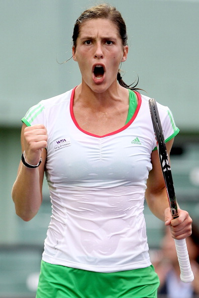 KEY BISCAYNE, FL - MARCH 29:  Andrea Petkovic of Germany celebrates a point against Jelena Jankovic of Serbia during the Sony Ericsson Open at Crandon Park Tennis Center on March 29, 2011 in Key Biscayne, Florida.  (Photo by Matthew Stockman/Getty Images)
