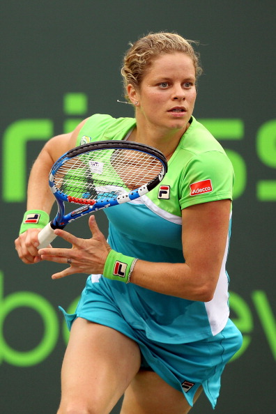 KEY BISCAYNE, FL - MARCH 29:  Kim Clijsters of Belgium runs towards the net against Ana Ivanovic of Serbia during the Sony Ericsson Open at Crandon Park Tennis Center on March 29, 2011 in Key Biscayne, Florida.  (Photo by Al Bello/Getty Images)