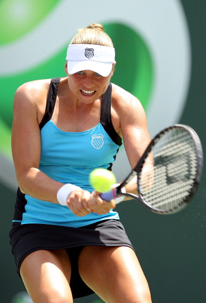 KEY BISCAYNE, FL - MARCH 30:  Vera Zvonareva of Russia hits a backhand return against Agnieszka Radwanska of Poland during the Sony Ericsson Open at Crandon Park Tennis Center on March 30, 2011 in Key Biscayne, Florida.  (Photo by Al Bello/Getty Images)