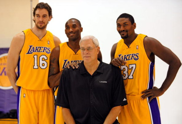 EL SEGUNDO, CA - SEPTEMBER 29:  Pau Gasol #16, Kobe Bryant #24, Coach Phil Jackson and Ron Artest #37 of the Los Angeles Lakers pose for a photograph during Lakers media day at their training facility on  September 29, 2009 in El Segundo, California. NOTE
