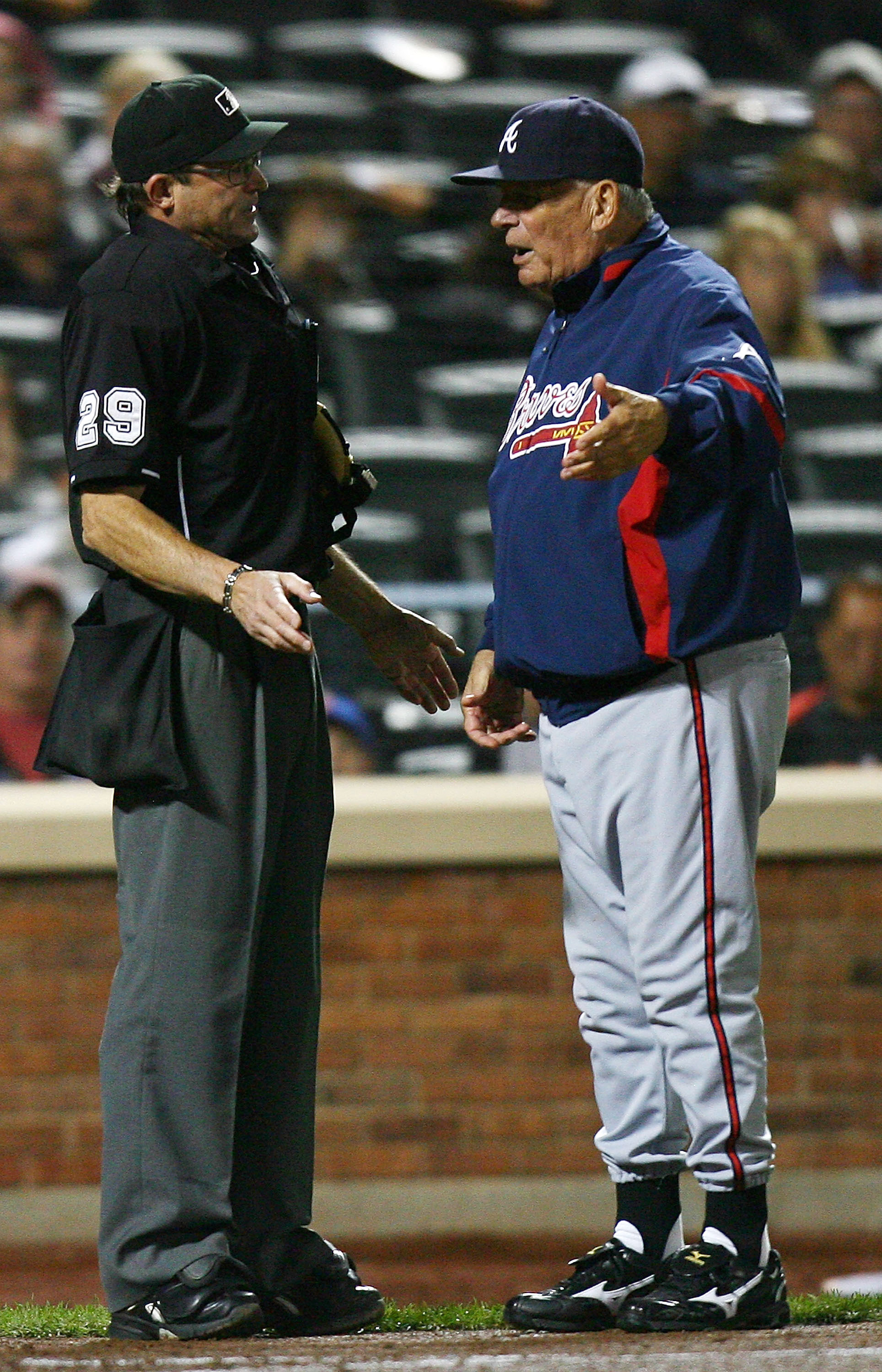 NEW YORK - SEPTEMBER 17:  Home plate umpire Bill Hohn #29 argues with Bobby Cox of the Atlanta Braves during a game against the New York Mets on September 17, 2010 at Citi Field in the Flushing neighborhood of the Queens borough of New York City.  (Photo