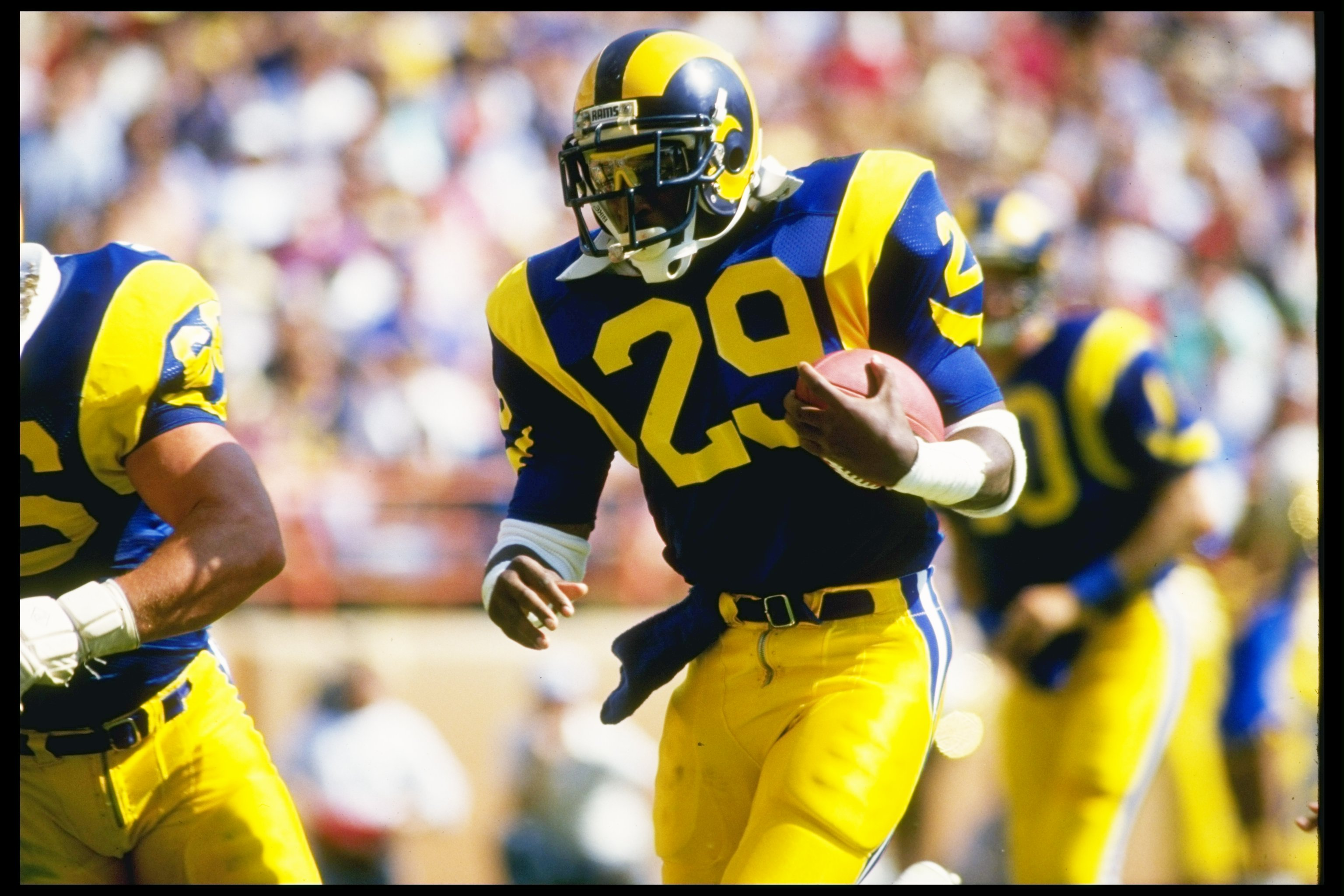 19 Oct 1986:  Running back Eric Dickerson of the Los Angeles Rams moves the ball during a game against the Detroit Lions at Anaheim Stadium in Anaheim, California.  The Rams won the game, 14-10. Mandatory Credit: Mike Powell  /Allsport