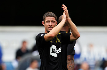 LONDON, ENGLAND - AUGUST 13:  Gary Cahill of Bolton applauds the fans after the Barclays Premier League match between Queens Park Rangers and Bolton Wanderers at Loftus Road on August 13, 2011 in London, England.  (Photo by Michael Steele/Getty Images)