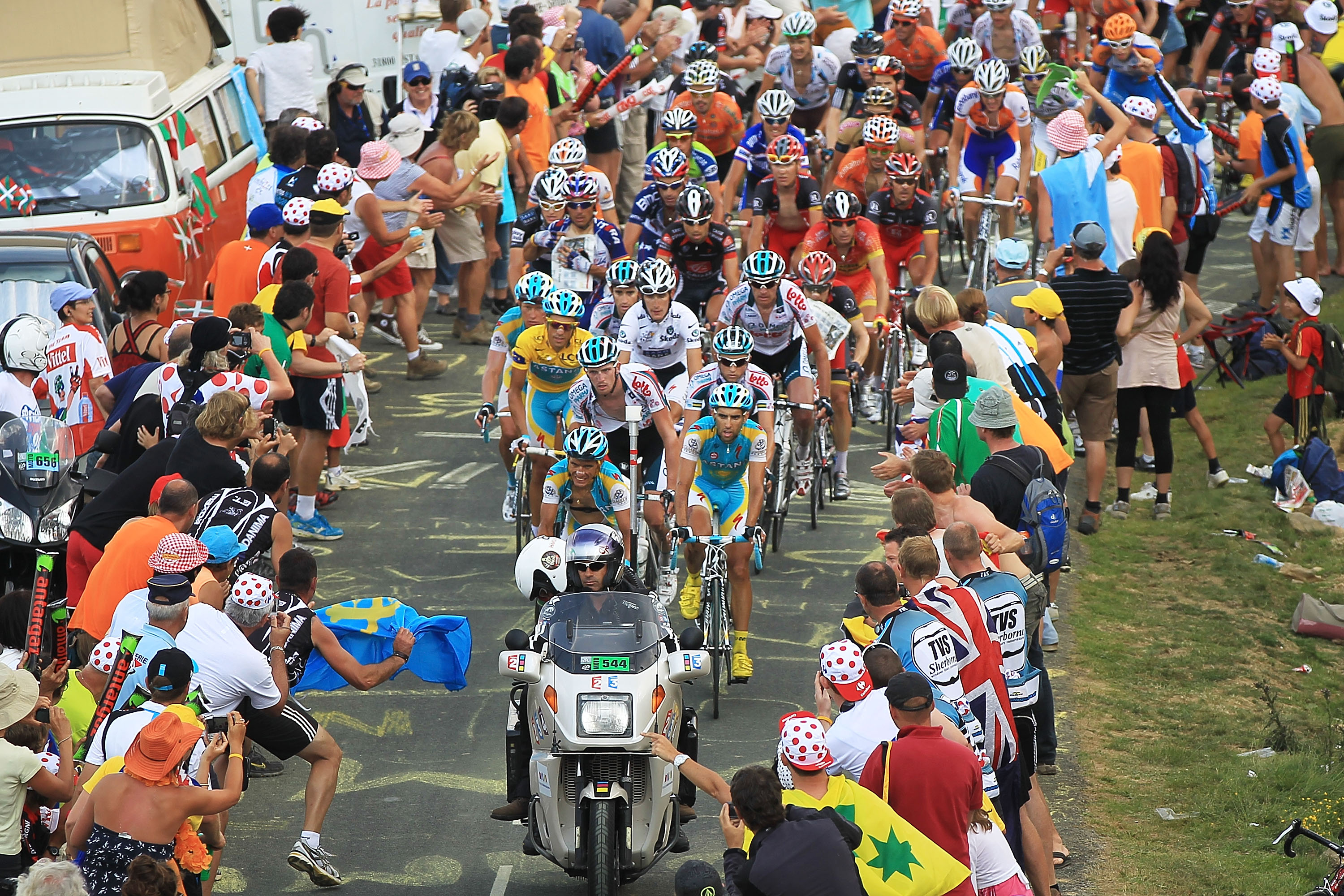 PAU, FRANCE - JULY 20: Thousands cheer on the peloton as they come to the top of the Col du Tourmalet during stage 16 of the Tour de France on July 20, 2010 in Pau, France. The stage, between Bagneres-de-Luchon and Pau, featured four major climbs includin