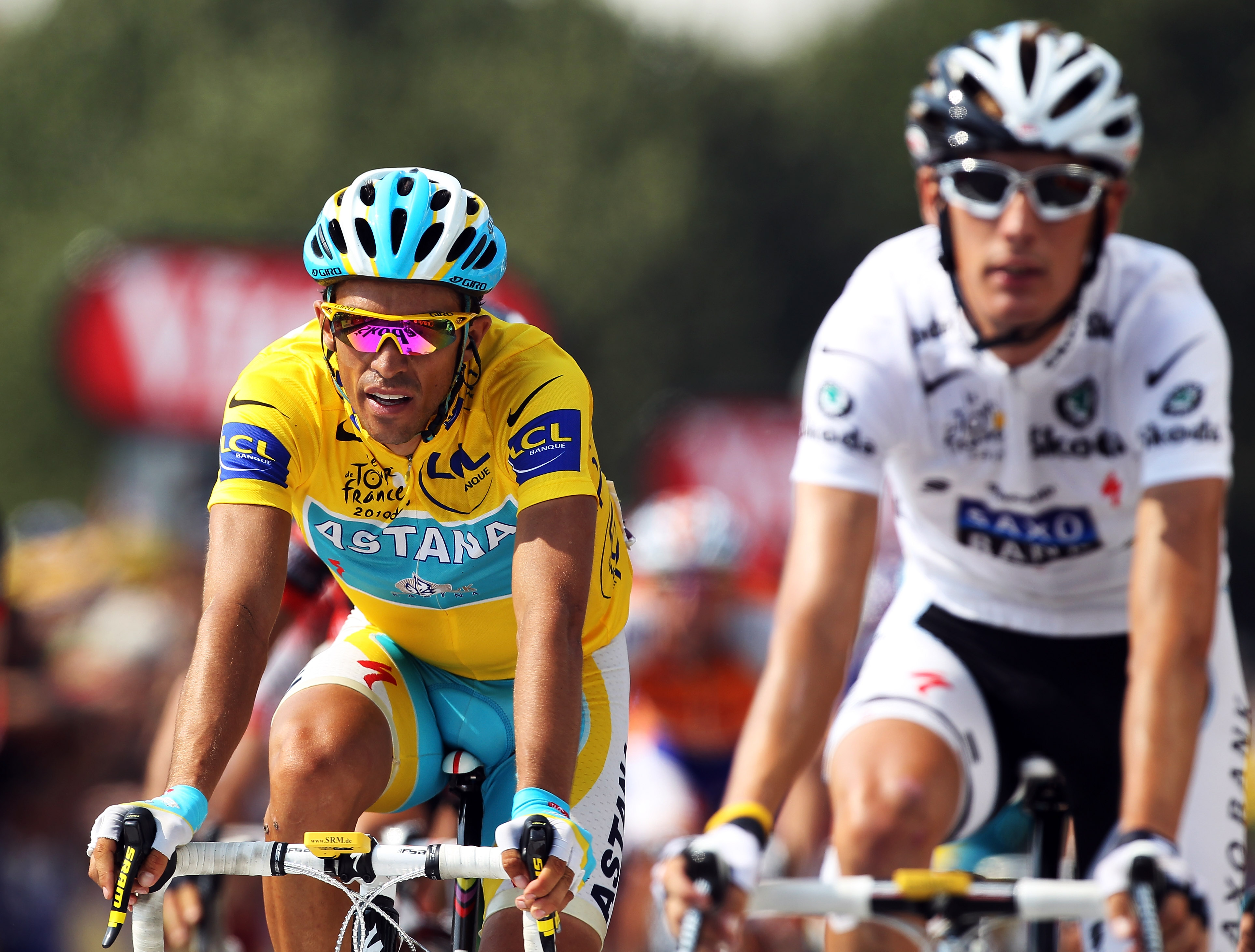 PAU, FRANCE - JULY 20:  Race leader Alberto Contador (l) of Spain and the Astana team rides over the finish line alongside second placed Andy Schleck of Luxembourg and Team Saxo Bank on stage sixteen of the 2010 Tour de France from Bagneres-de-Luchon to P