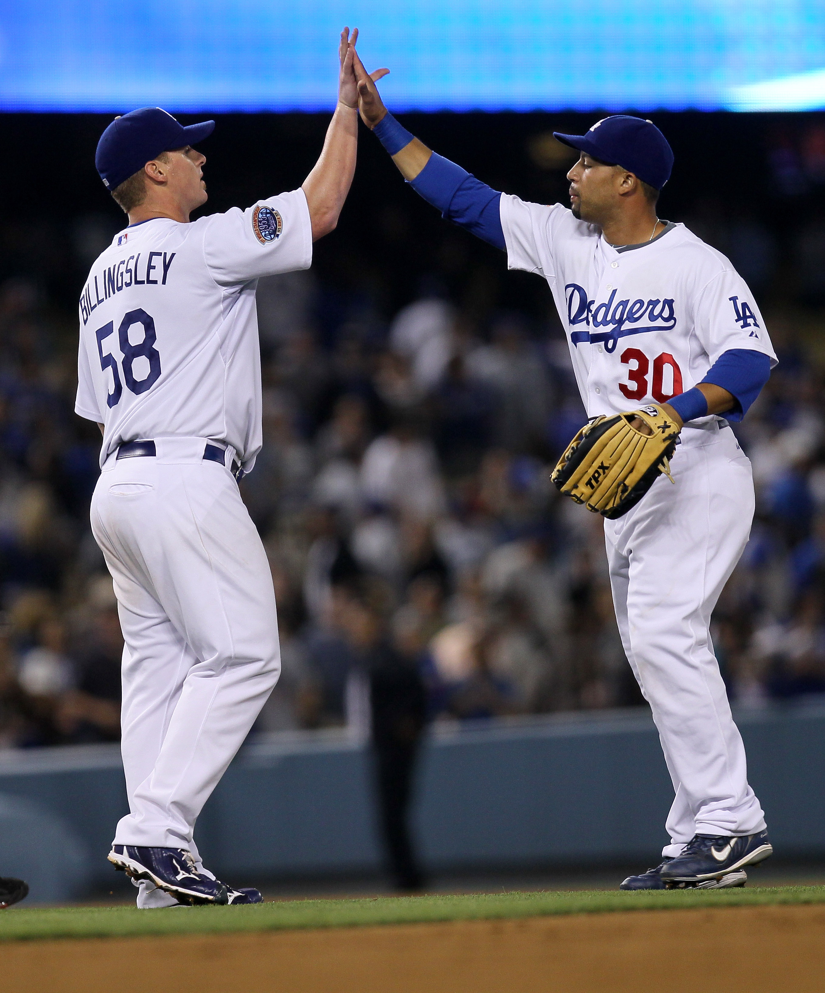 LOS ANGELES, CA - JULY 21:  Pitcher Chad Billingsley #58 of the Los Angeles Dodgers is congratulated by outfielder Xavier Paul #30 after his complete game shutout against the San Francisco Giants on July 21, 2010 at Dodger Stadium in Los Angeles, Californ