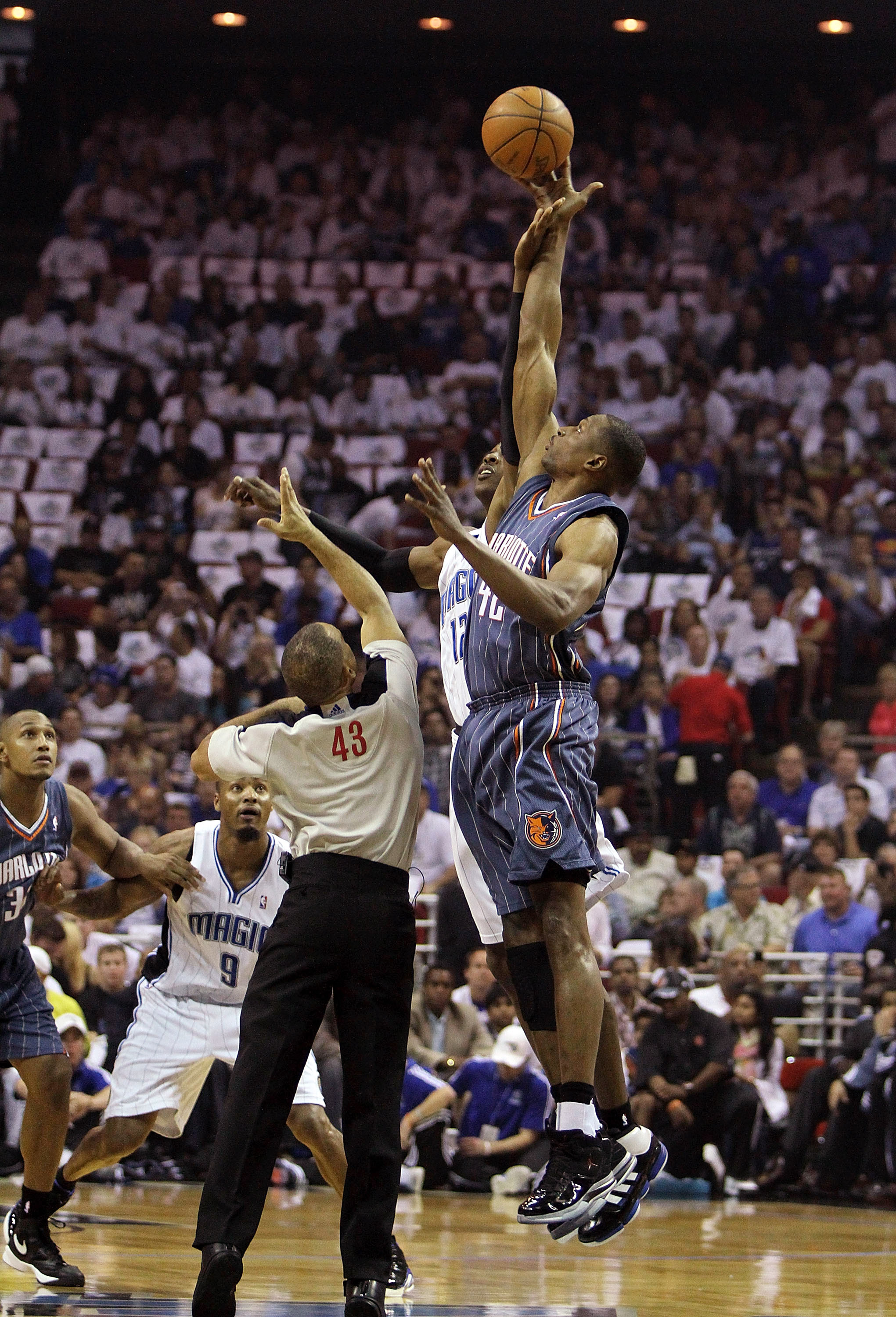 ORLANDO, FL - APRIL 18:  Theo Ratliff #42 of the Charlotte Bobcats gets the opening tip over Dwight Howard #12 of the Orlando Magic after being tossed into the air by official Dan Crawford  #43 in Game One of the Eastern Conference Quarterfinals during th
