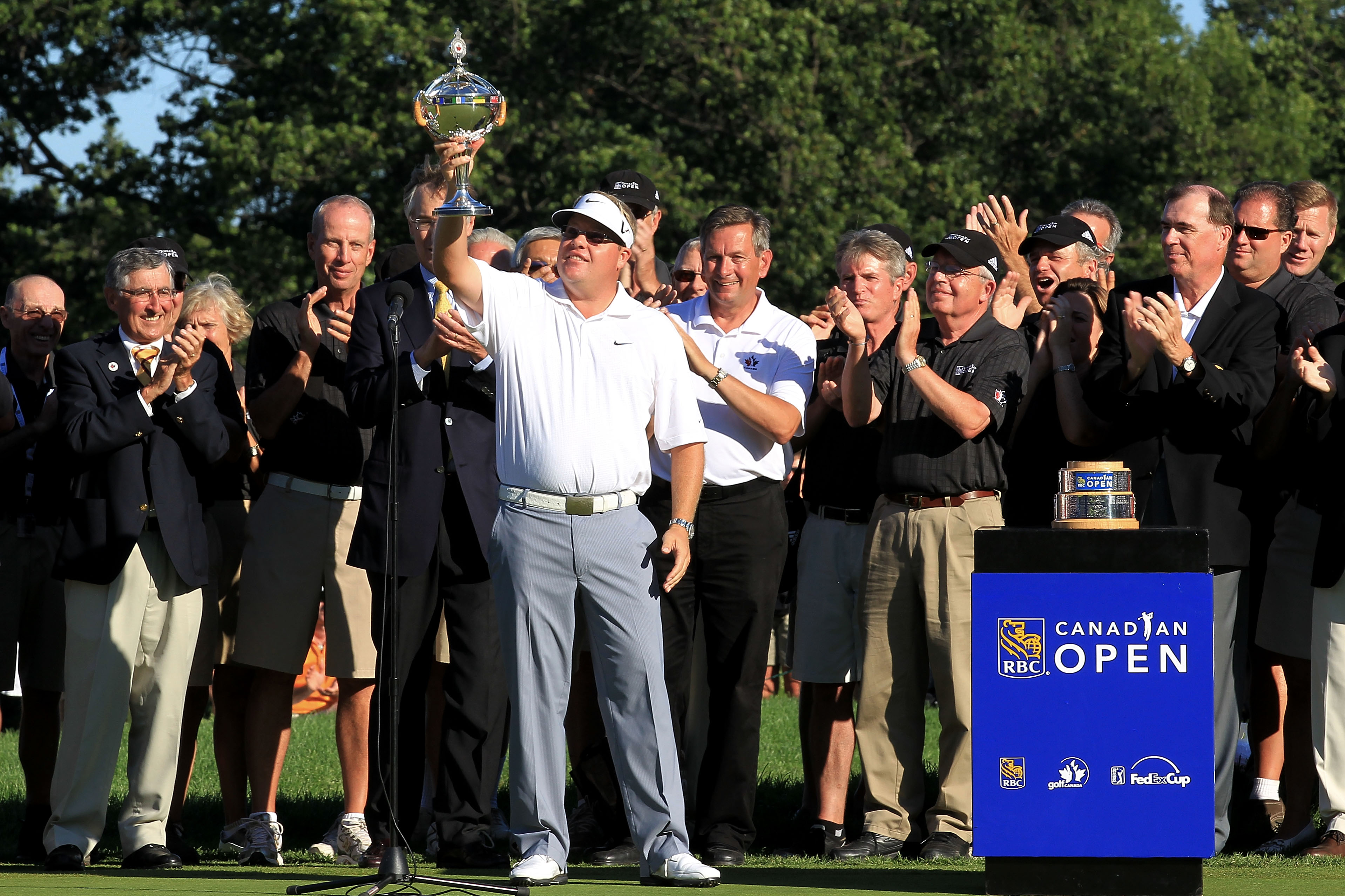 Carl Pettersson Hoists His Trophy After Winning the RBC Canadian Open