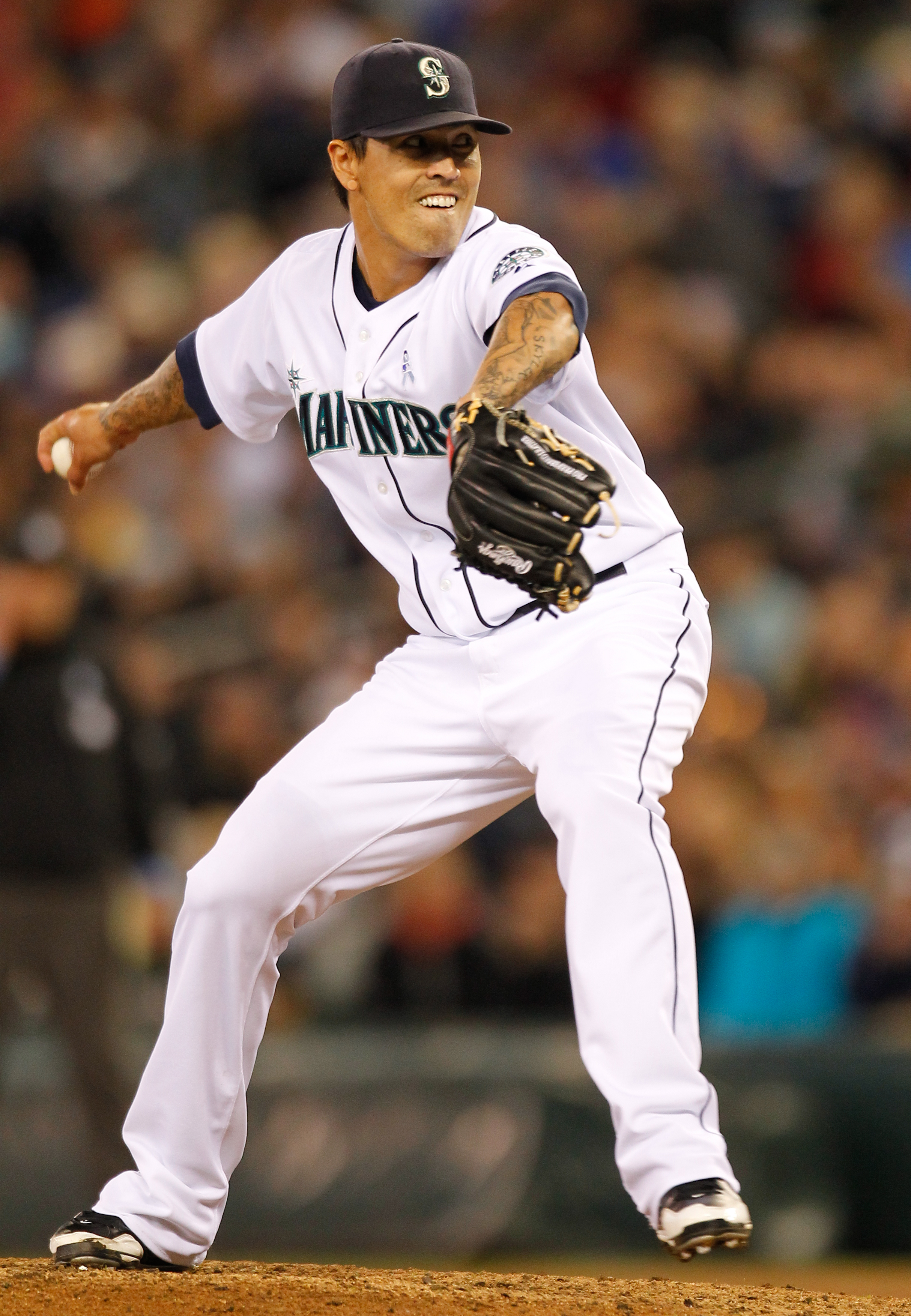 SEATTLE - JUNE 20:  Relief pitcher Brandon League #43 of the Seattle Mariners pitches against the Cincinnati Reds on June 20, 2010 at Safeco Field in Seattle, Washington. (Photo by Otto Greule Jr/Getty Images)