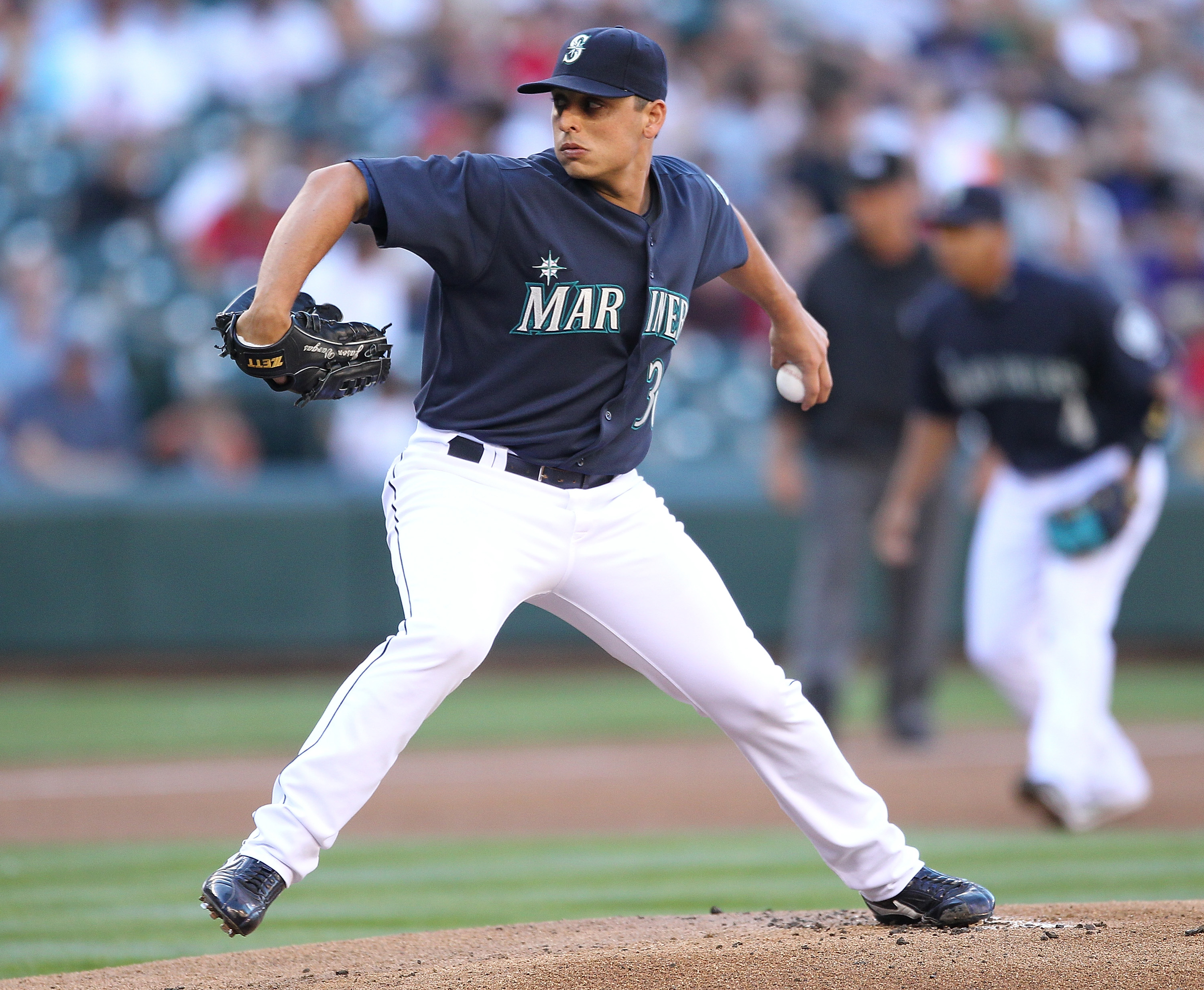 SEATTLE - JULY 23:  Starting pitcher Jason Vargas #38 of the Seattle Mariners pitches against the Boston Red Sox at Safeco Field on July 23, 2010 in Seattle, Washington. (Photo by Otto Greule Jr/Getty Images)