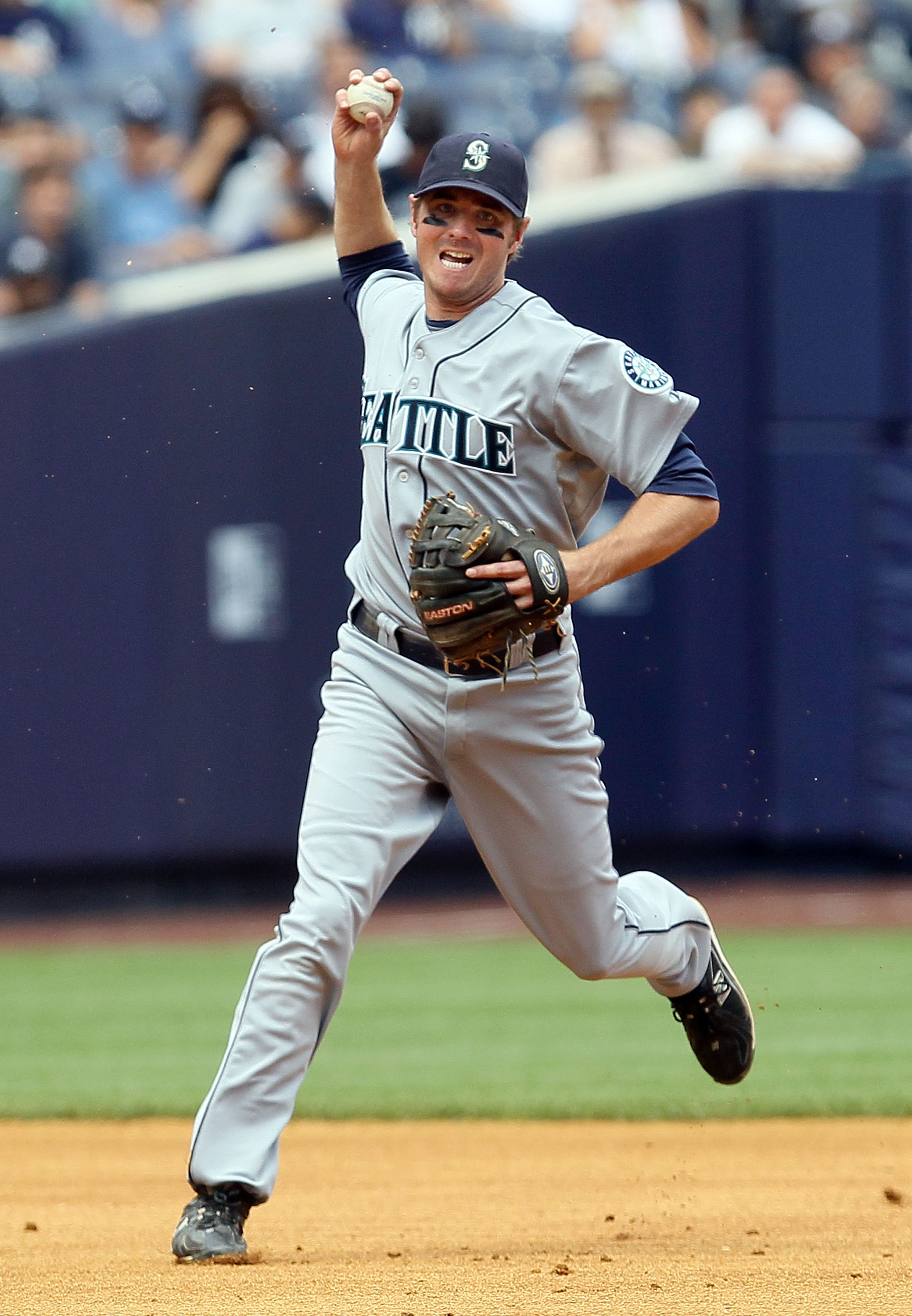 NEW YORK - JULY 01:  Josh Wilson #16 of the Seattle Mariners throws to first base for an out against Derek Jeter (not pictured) of the New York Yankees in the fifth inning on July 1, 2010 at Yankee Stadium in the Bronx borough of New York City.  (Photo by