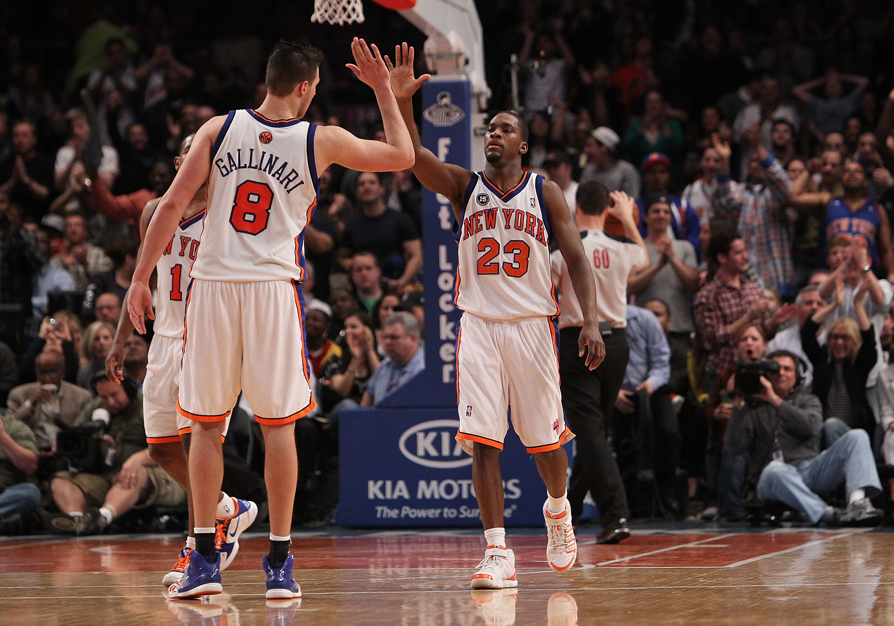 NEW YORK - MARCH 19: Toney Douglas #23 of the New York Knicks celebrates a basket with teammate Danilo Gallinari #8 against the Philadelphia 76ers at Madison Square Garden on March 19, 2010 in New York City. NOTE TO USER: User expressly acknowledges and a