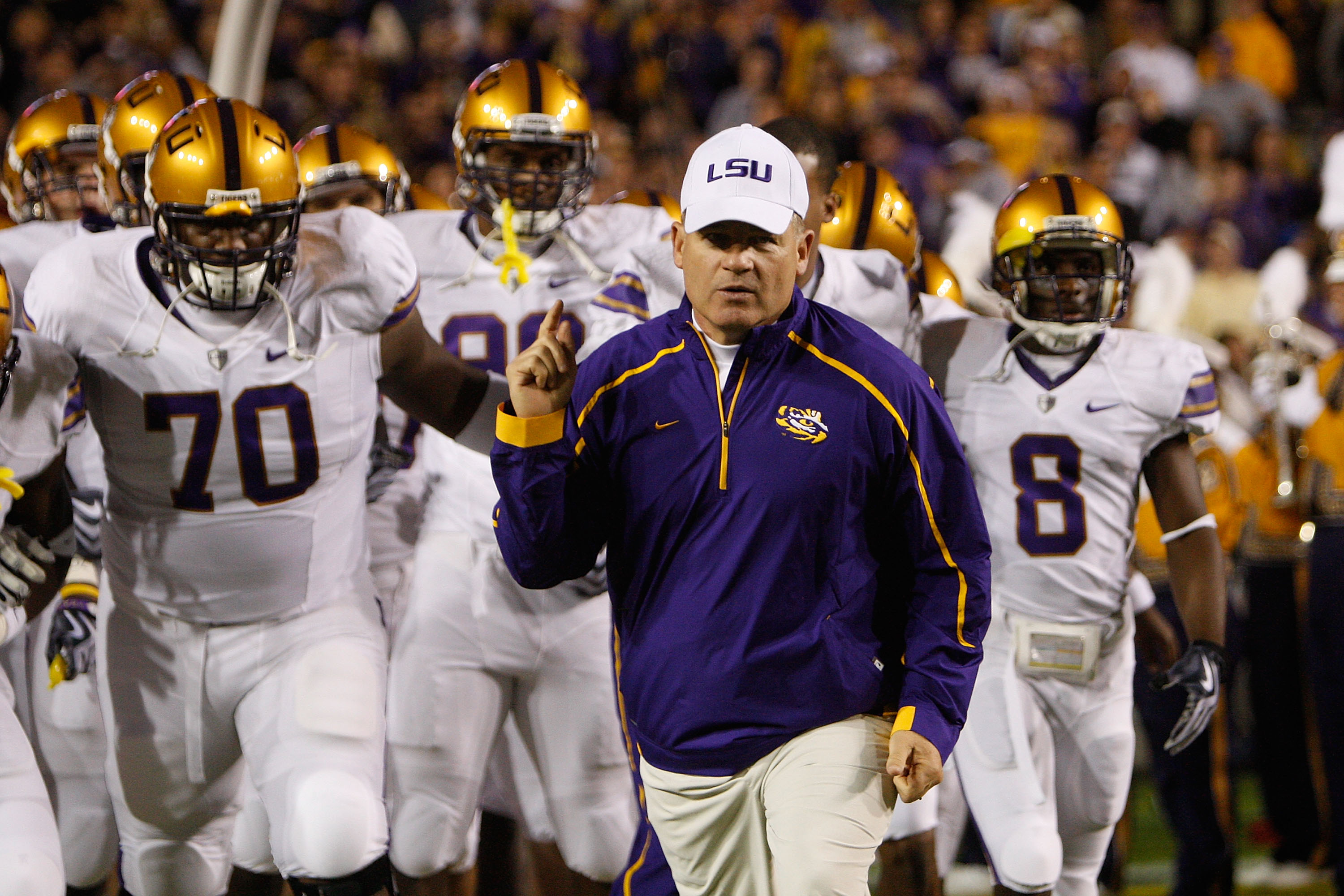 BATON ROUGE, LA - NOVEMBER 28:  Head coach Les Miles of the LSU Tigers takes the field before the game against the Arkansa Razorbacks at Tiger Stadium on November 28, 2009 in Baton Rouge, Louisiana.  The Tigers defeated the Razorbacks 33-30 in overtime.
