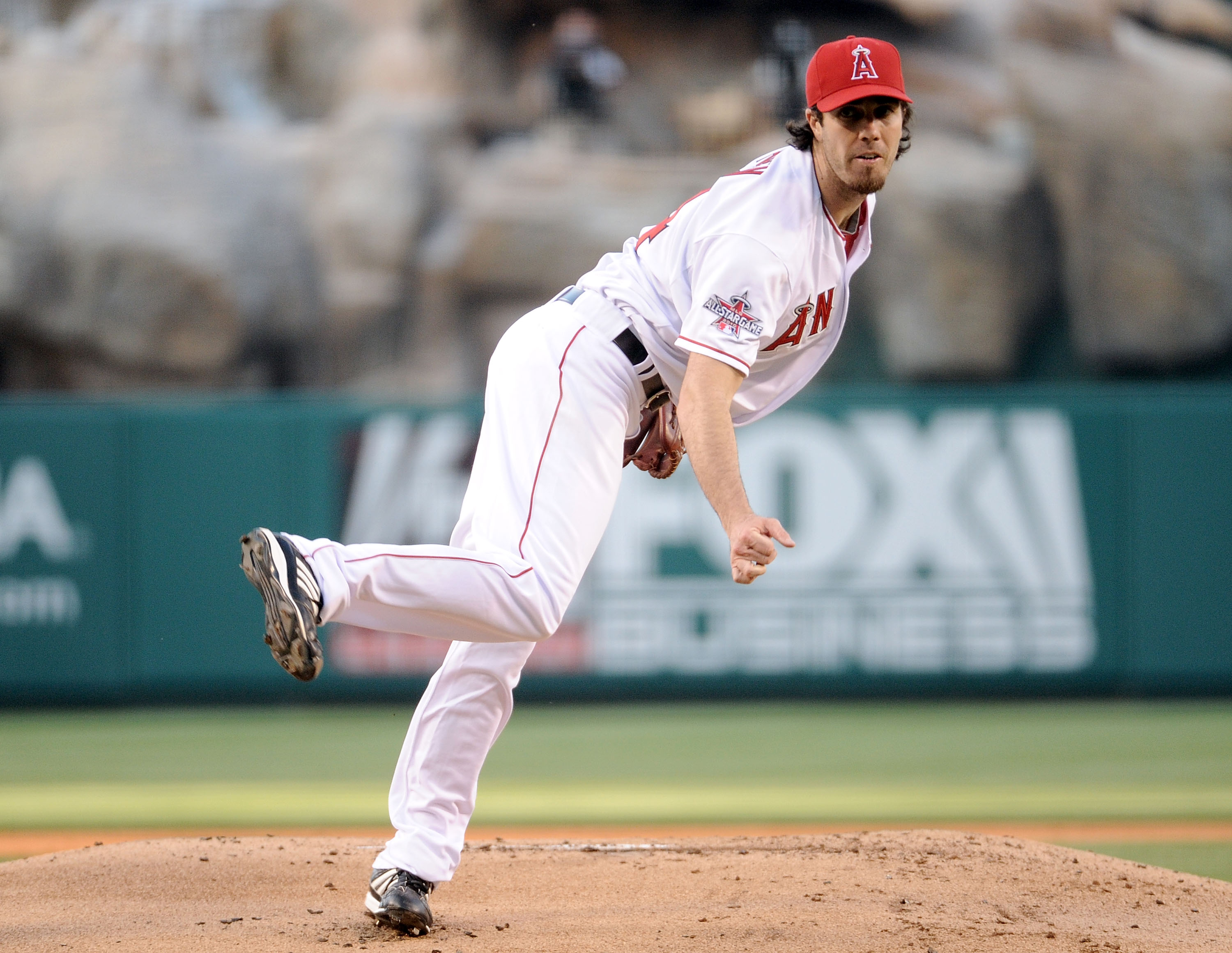 ANAHEIM, CA - JULY 26:  Dan Haren #24 of the  Los Angeles Angels pitches against the Boston Red Sox during the first inning at Angel Stadium on July 26, 2010 in Anaheim, California.  (Photo by Harry How/Getty Images)