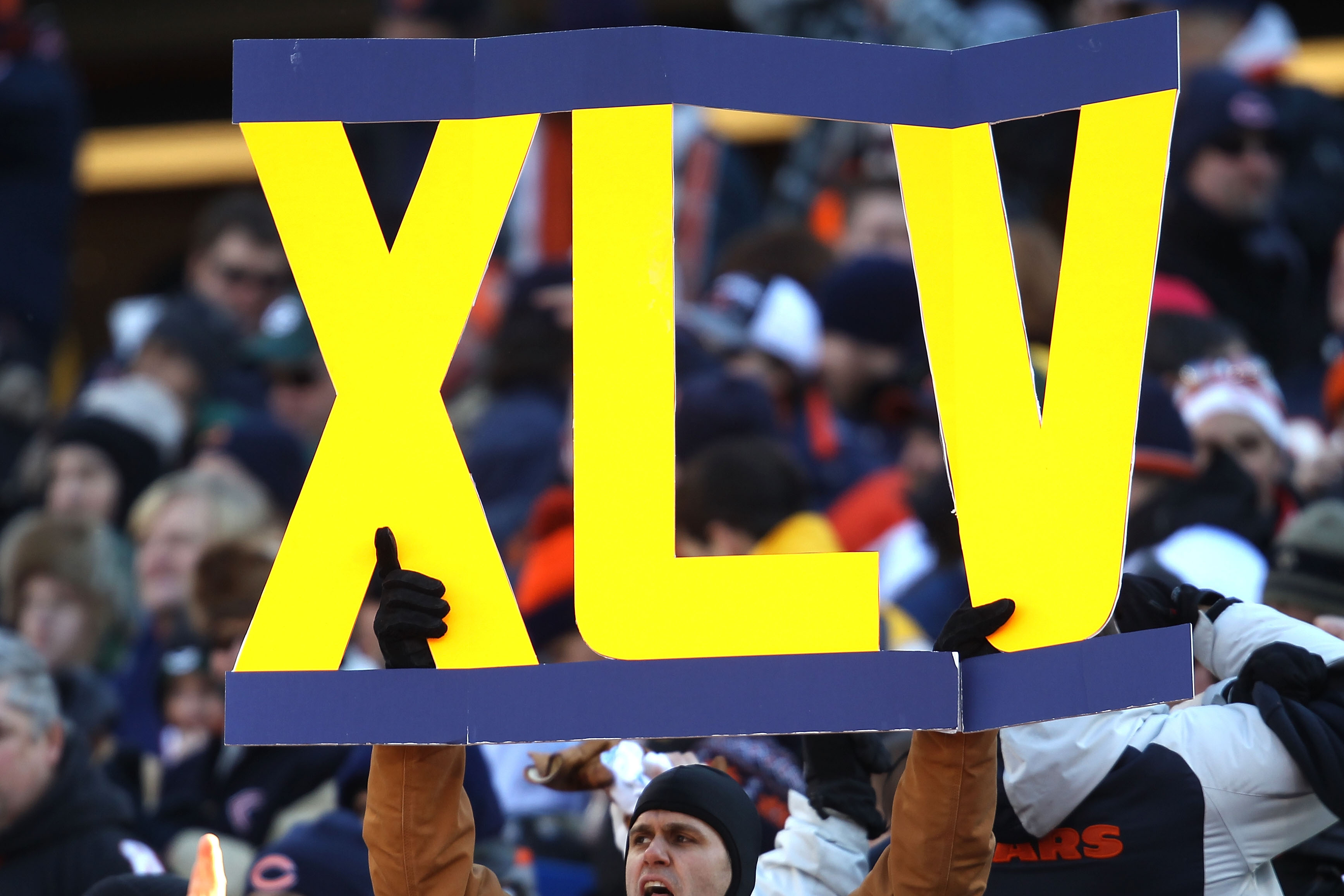 CHICAGO, IL - JANUARY 23:  A fan holds a sign 'XLV'  for the Super Bowl in two weeks in Arlington, Texas in the NFC Championship Game at Soldier Field on January 23, 2011 in Chicago, Illinois.  (Photo by Jonathan Daniel/Getty Images)