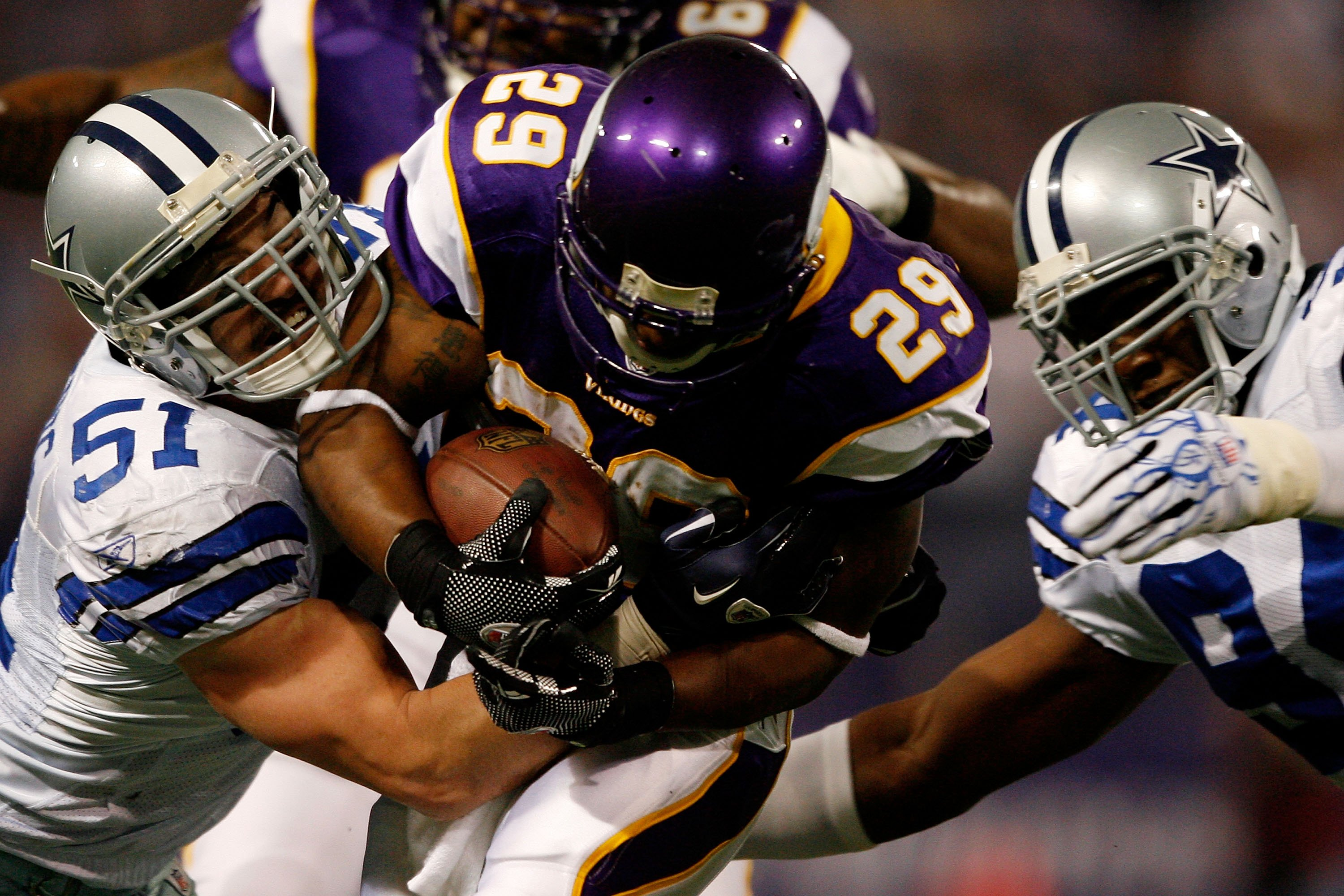 MINNEAPOLIS - JANUARY 17:  Running back Chester Taylor #29 of the Minnesota Vikings is tackled by Keith Brooking #51 of the Dallas Cowboys during the NFC Divisional Playoff Game at Hubert H. Humphrey Metrodome on January 17, 2010 in Minneapolis, Minnesota