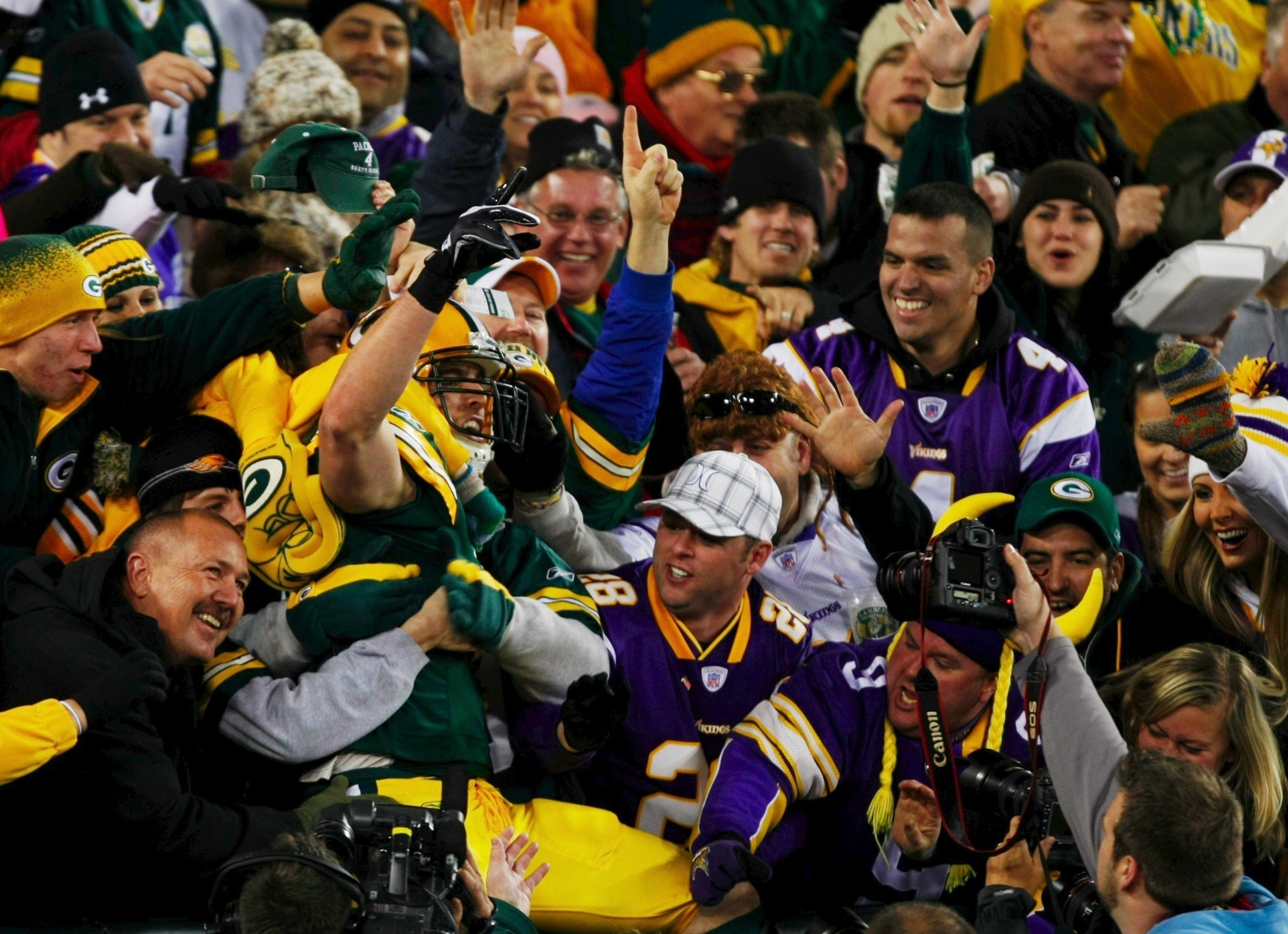GREEN BAY, WI - NOVEMBER 01:  Spencer Havner #41 of the Green Bay Packers leaps into the stands to celebrate his touchdown with fans during the third quarter of the game against the Minnesota Vikings at Lambeau Field on November 1, 2009 in Green Bay, Wisc
