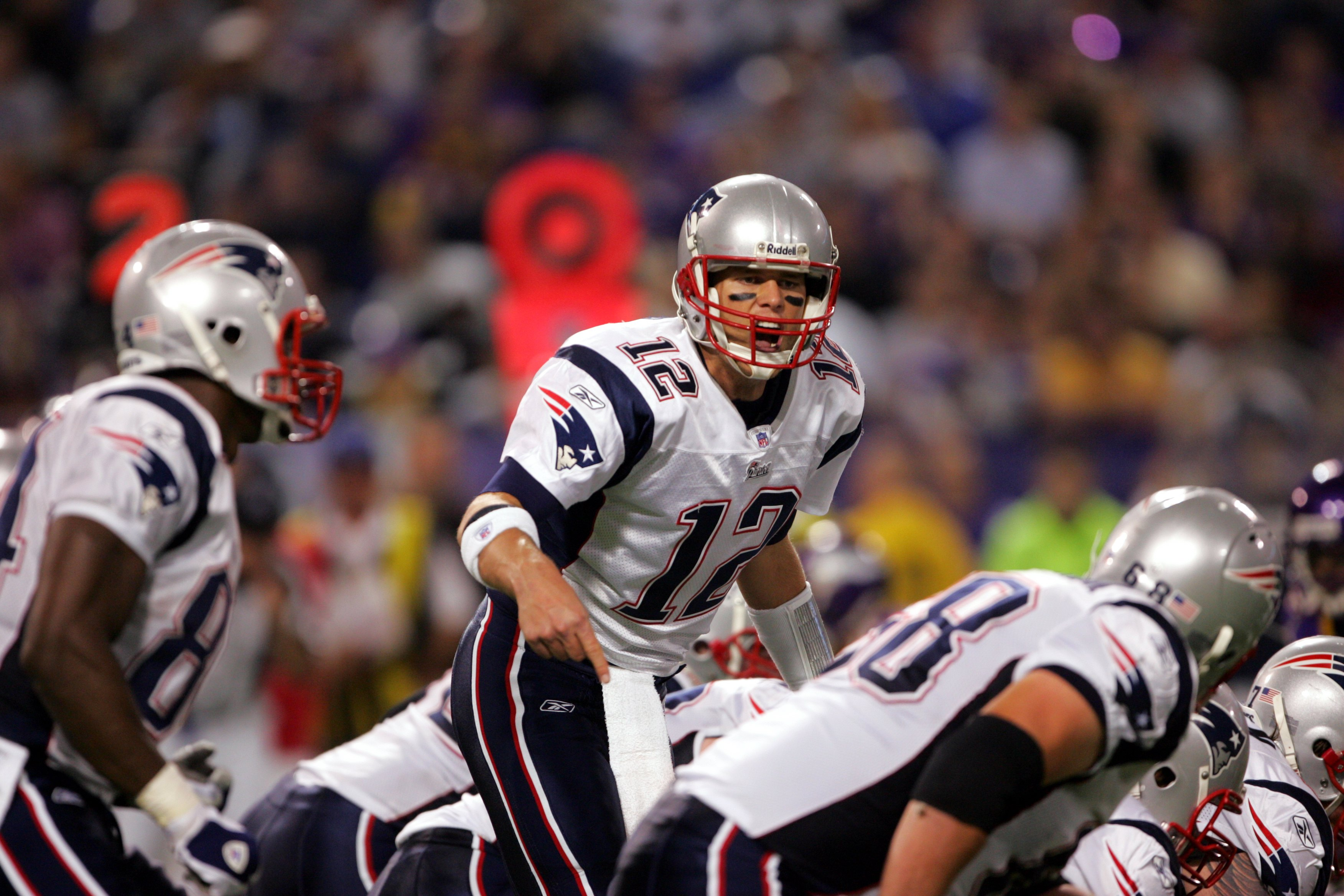 MINNEAPOLIS, MN - OCTOBER 30:  Quarterback Tom Brady #12 of the New England Patriots calls a play during the game against the Minnesota Vikings on October 30, 2006 at the Metrodome in Minneapolis, Minnesota. The Patriots won 31-7. (Photo by Stephen Dunn/G