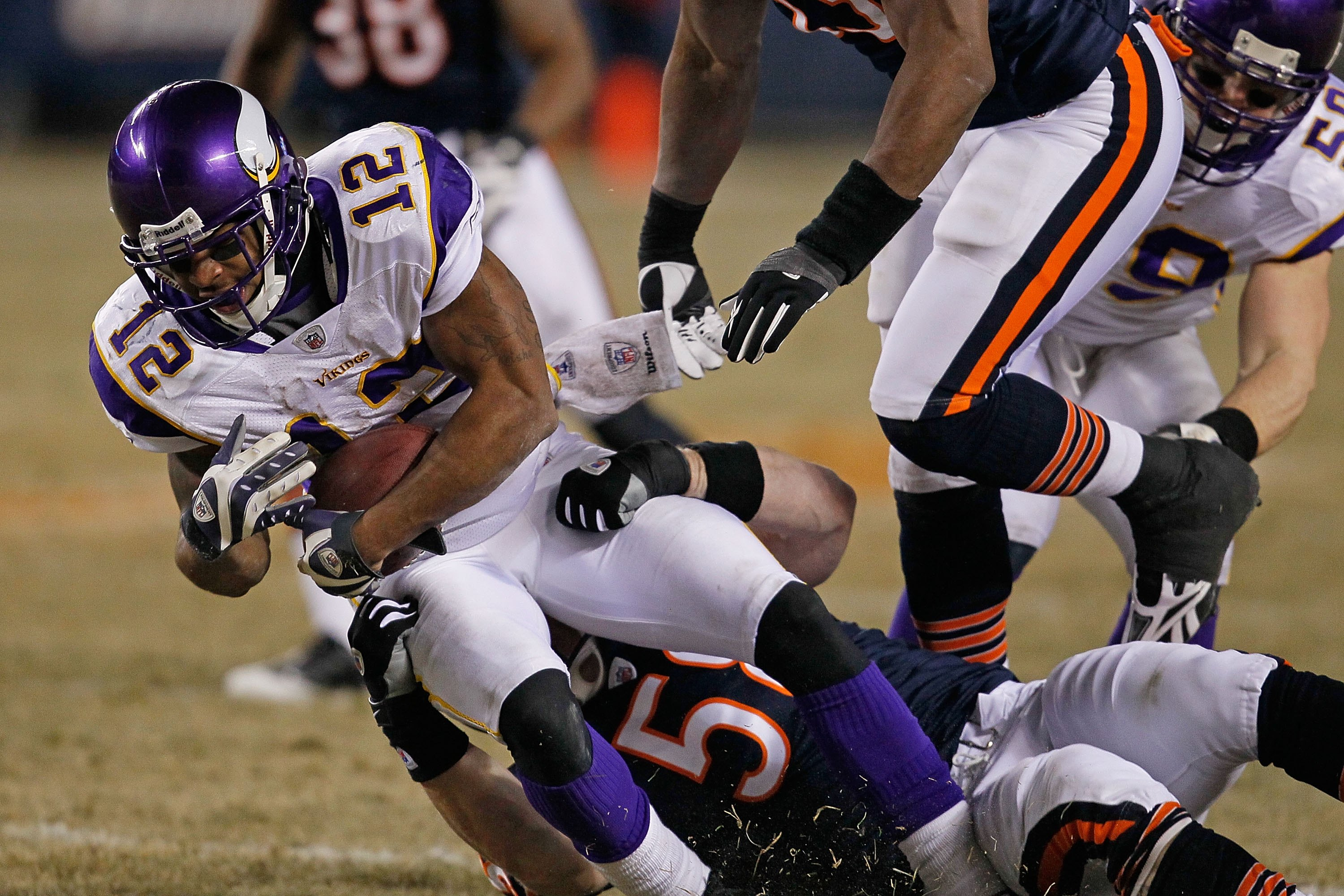CHICAGO - DECEMBER 28: Percy Harvin #12 of the Minnesota Vikings is tackled by Tim Shaw #58 of the Chicago Bears at Soldier Field on December 28, 2009 in Chicago, Illinois. The Bears defeated the Vikings 36-30 in overtime.  (Photo by Jonathan Daniel/Getty