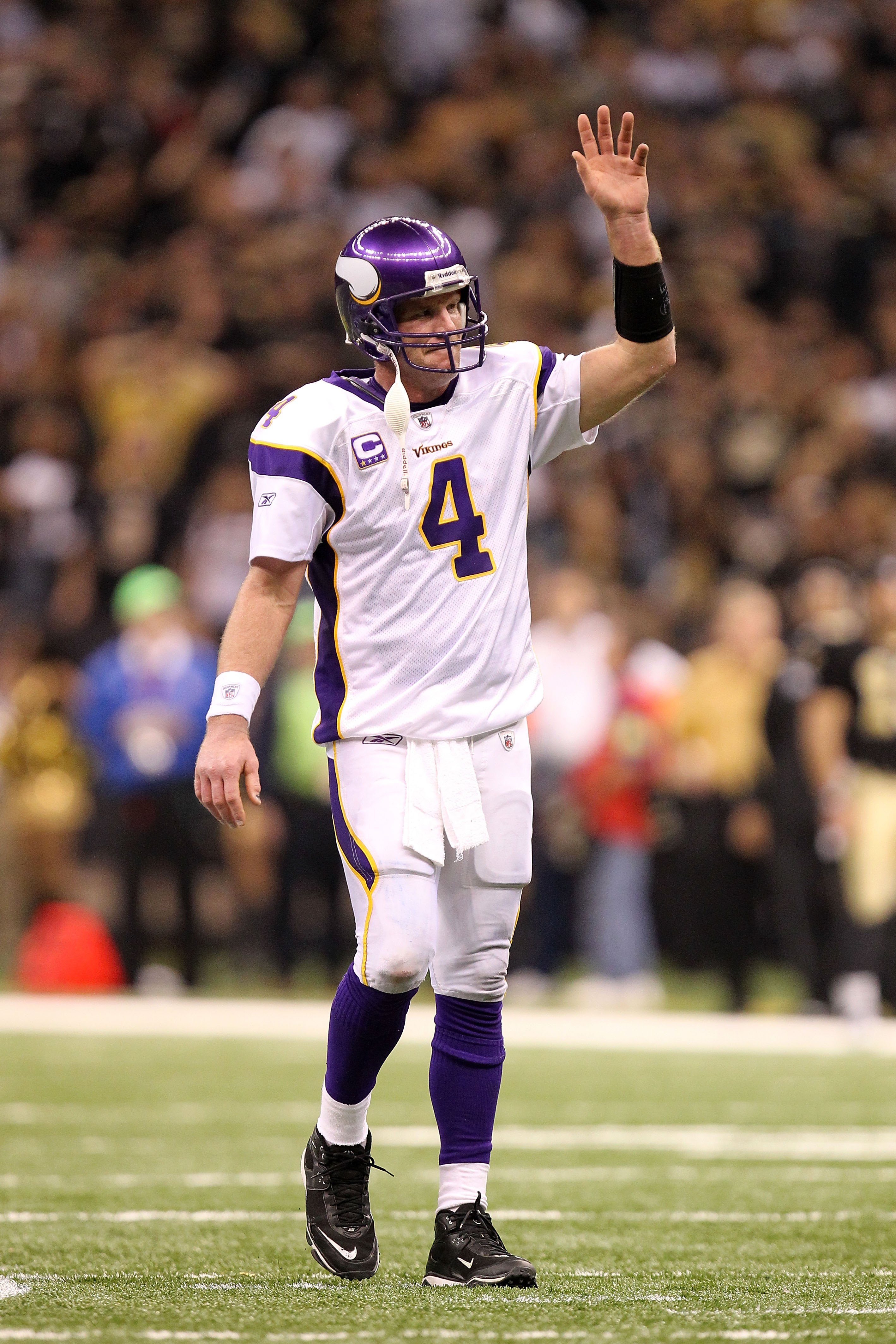 NEW ORLEANS - JANUARY 24:  Quarterback Brett Favre #4 of the Minnesota Vikings waves on the field against the New Orleans Saints during the NFC Championship Game at the Louisiana Superdome on January 24, 2010 in New Orleans, Louisiana. The Saints won 31-2