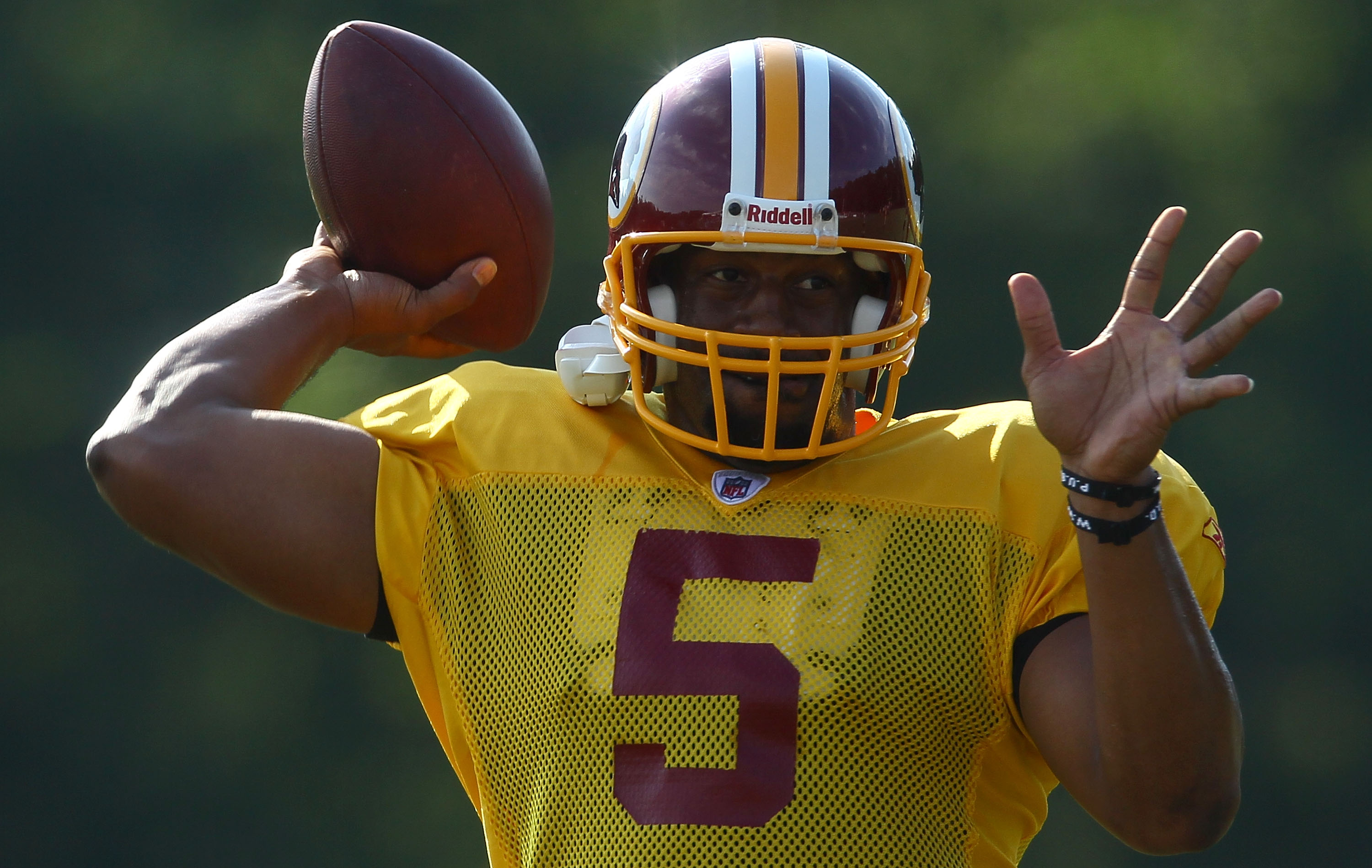 ASHBURN, VA - JULY 30:  Quarterback Donovan McNabb #5 of the Washington Redskins throws a pass during the second day of training camp July 30, 2010 in Ashburn, Virginia.  (Photo by Win McNamee/Getty Images)