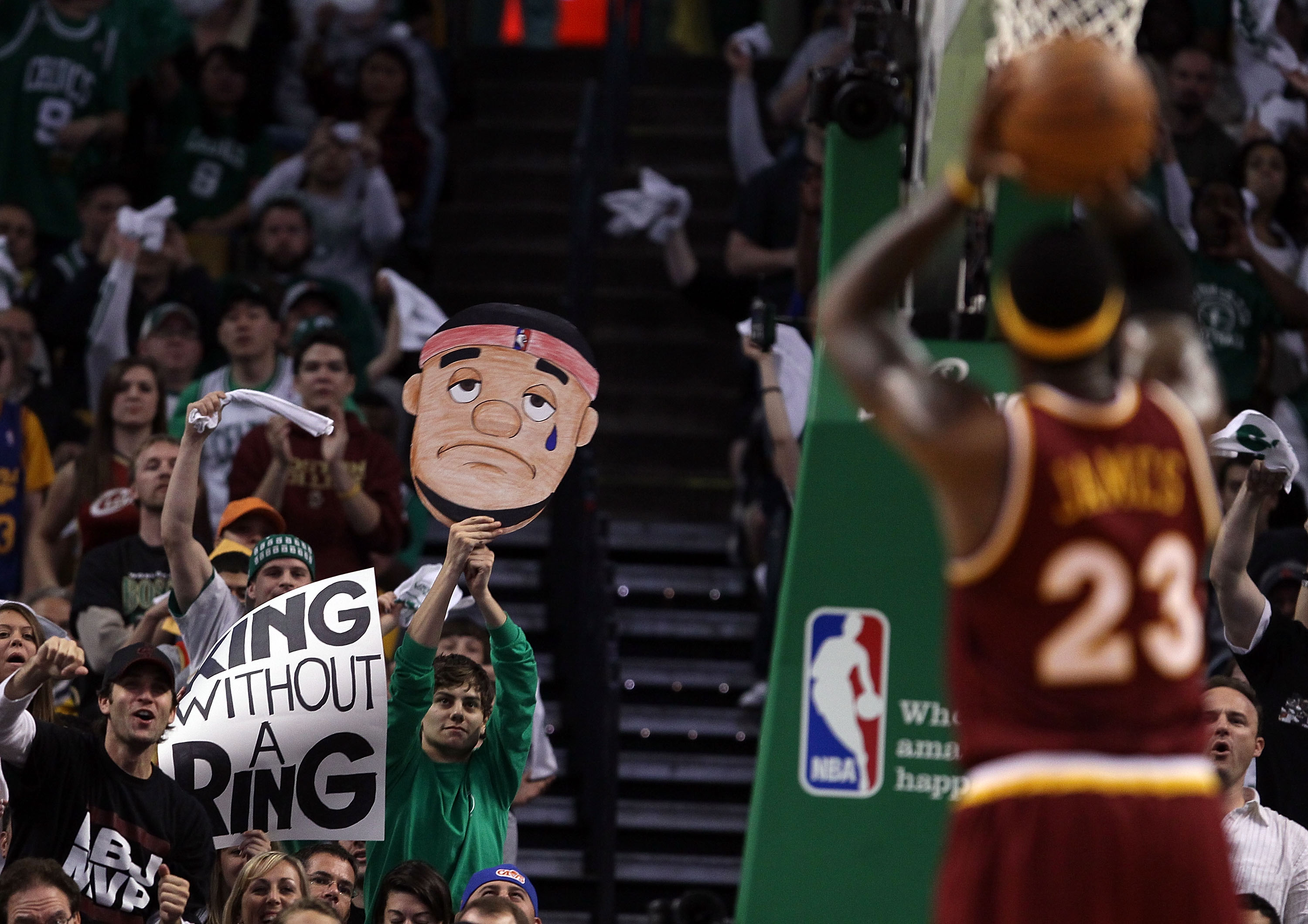 BOSTON - MAY 09:  Fans try to distract LeBron James #23 of the Cleveland Cavaliers as he tries to shoot a free throw in the first half against the Boston Celtics during Game Four of the Eastern Conference Semifinals of the 2010 NBA playoffs at TD Garden o