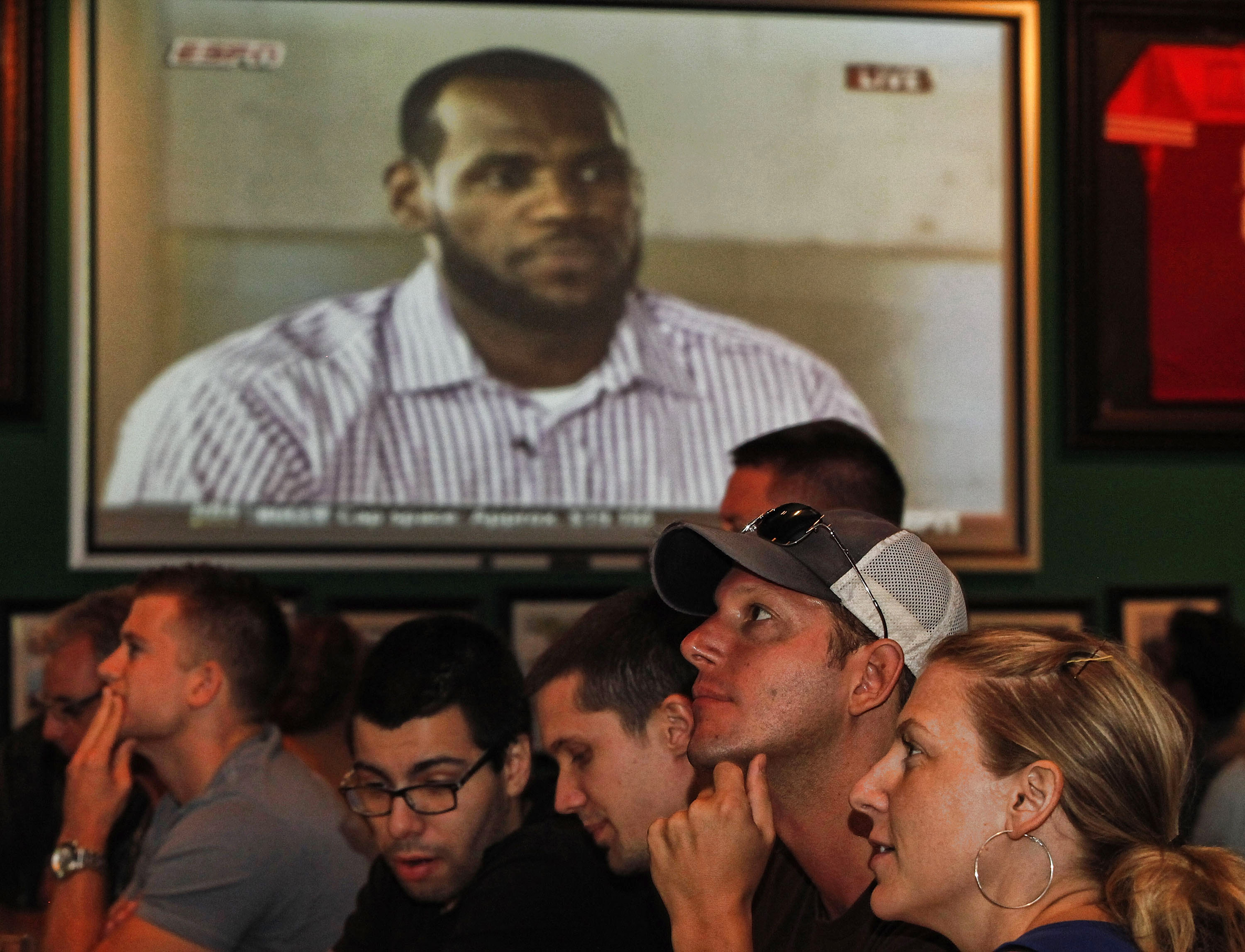 BOCA RATON, FL - JULY 08:  LeBron James announces he will join the Miami Heat during a televised interview as fans look on at Duffy's July 8, 2010 in Boca Raton, Florida.  (Photo by Marc Serota/Getty Images)