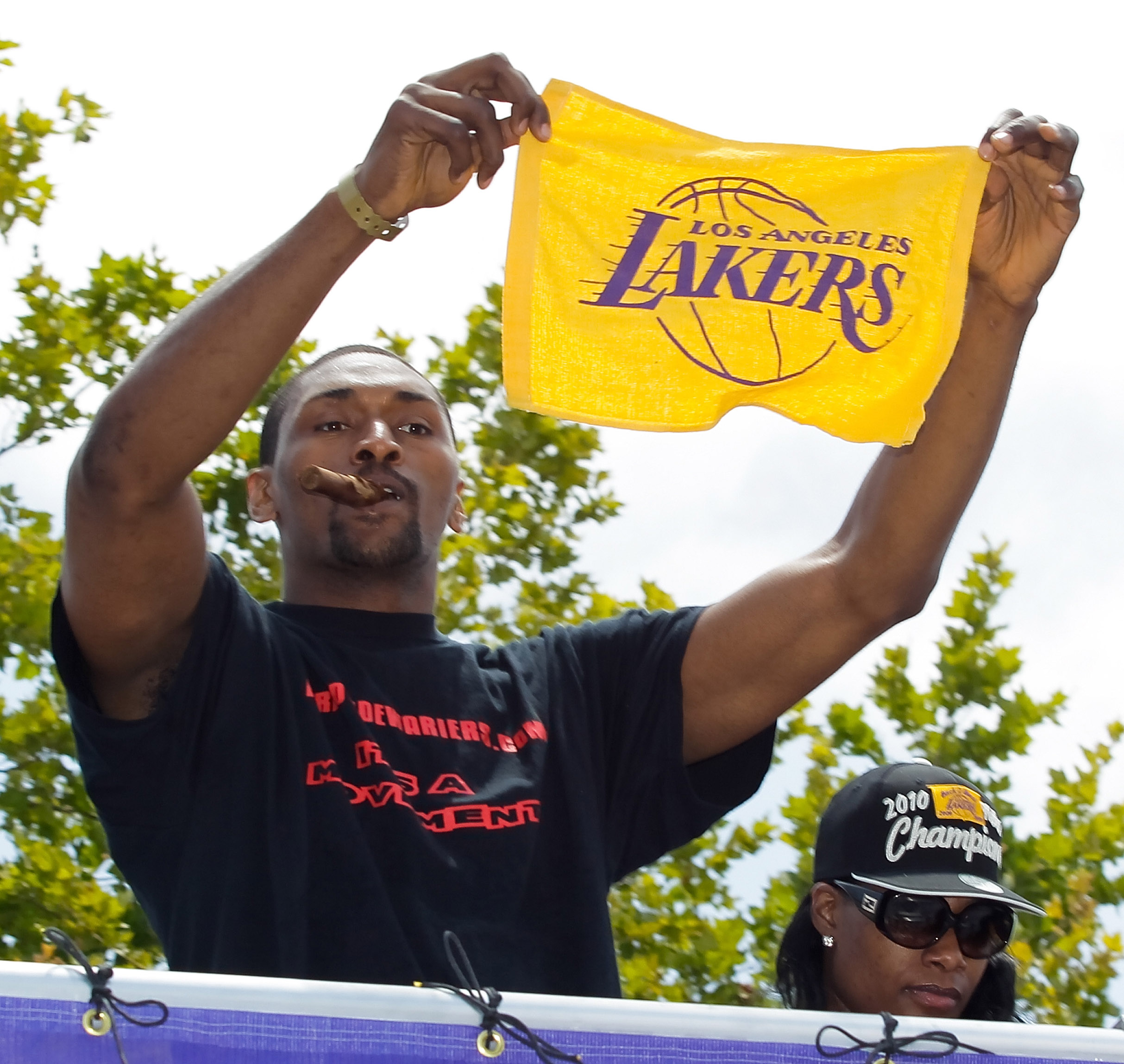 LOS ANGELES, CA - JUNE 21:  Los Angeles Lakers small forward Ron Artest salutes the crowd while riding in the victory parade for the the NBA basketball champion team on June 21, 2010 in Los Angeles, California. The Lakers beat the Boston Celtics 87-79 in