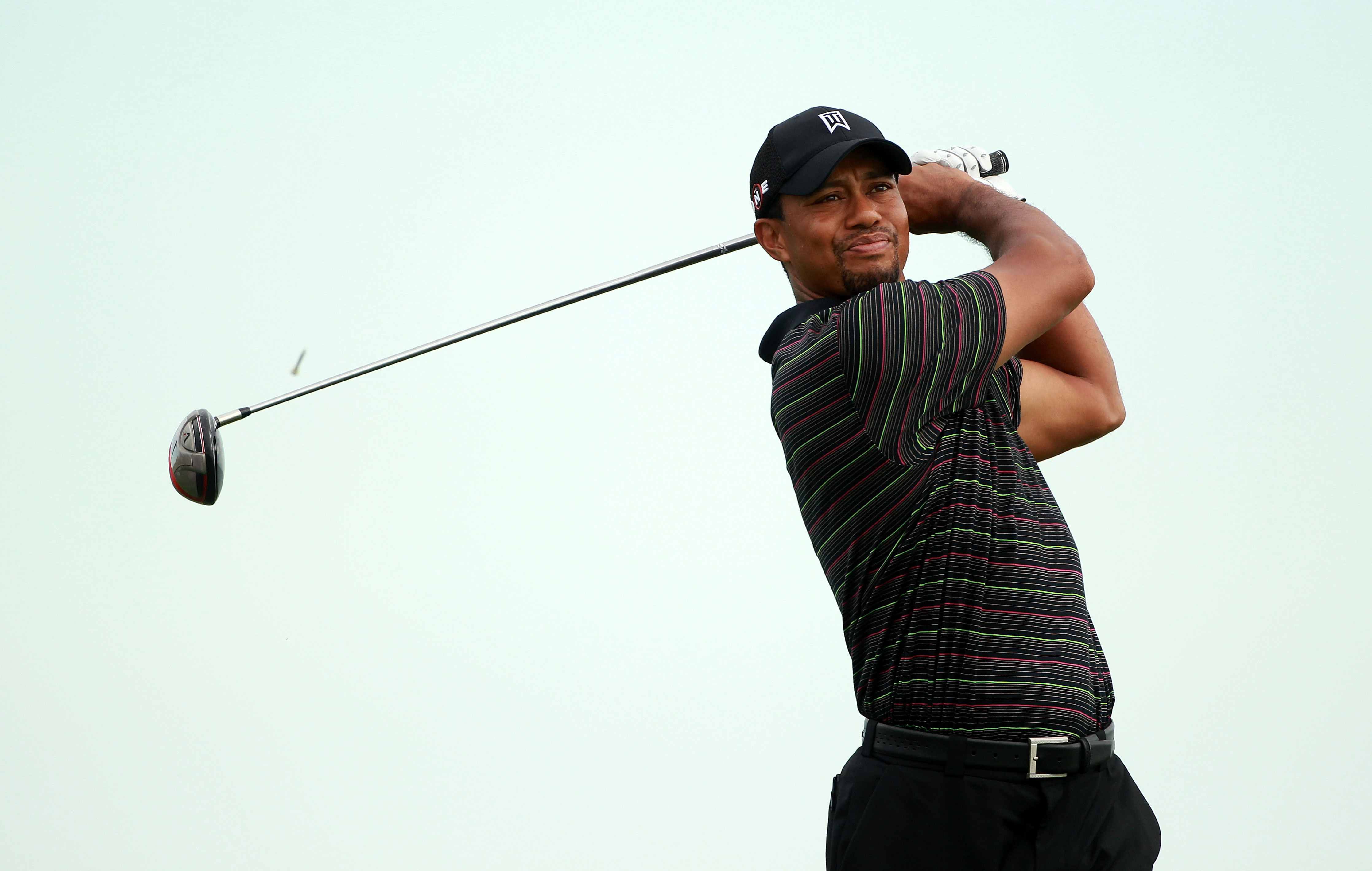 KOHLER, WI - AUGUST 09:  Tiger Woods plays a shot during a practice round prior to the start of the 92nd PGA Championship on the Straits Course at Whistling Straits on August 9, 2010 in Kohler, Wisconsin.  (Photo by Andrew Redington/Getty Images)