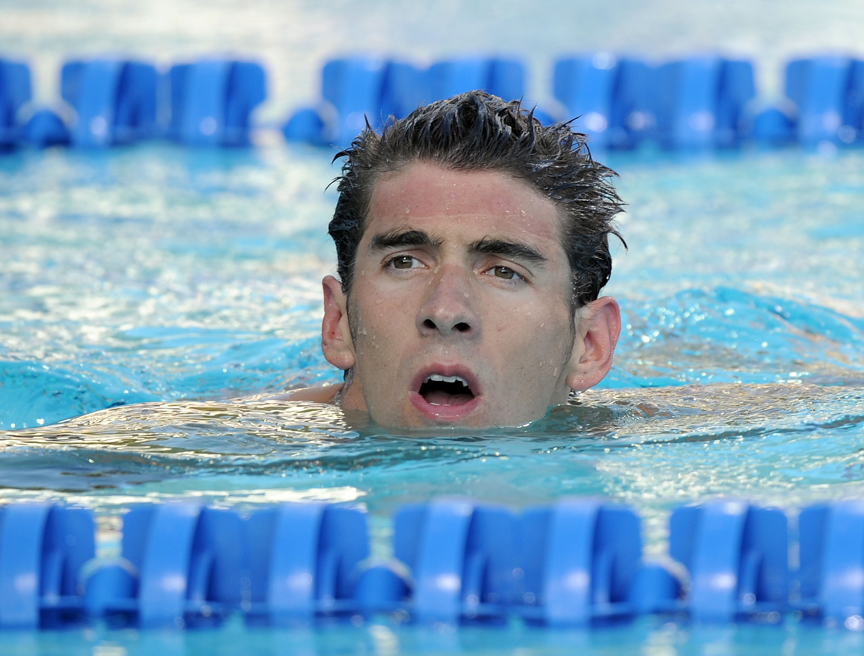 IRVINE, CA - AUGUST 07:  Michael Phelps reacts after his swim in the 200 LC Meter Backstroke Final during the 2010 ConocoPhillips National Championships at the William Woollett Jr. Aquatics Complex on August 7, 2010 in Irvine, California. Phelps finished