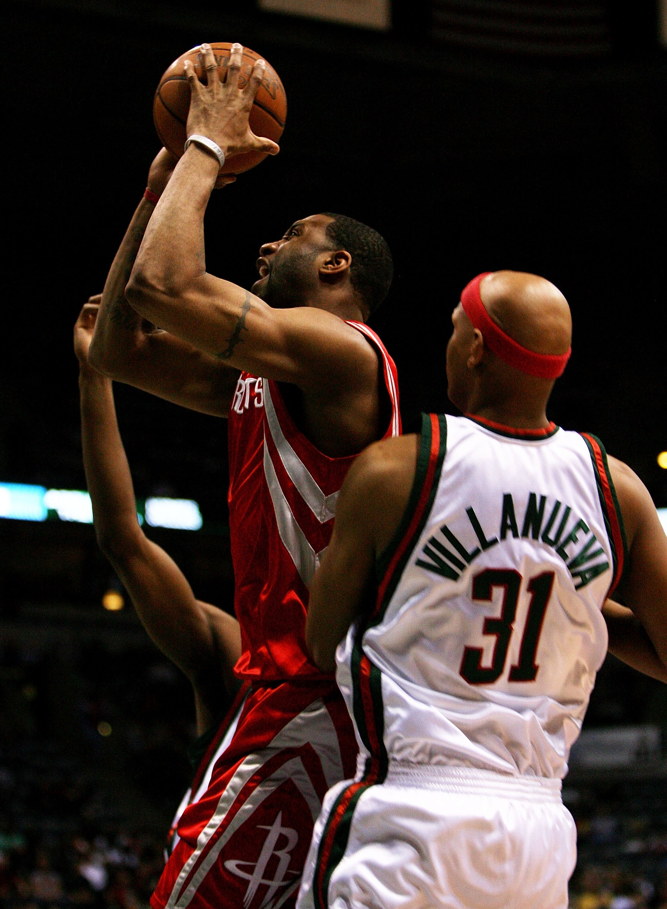 MILWAUKEE - FEBRUARY 09: Tracy McGrady #1 of the Houston Rockets drives past Charlie Villanueva #31 of the Milwaukee Bucks on February 9, 2009 at the Bradley Center in Milwaukee, Wisconsin. The Bucks defeated the Rockets 124-112. NOTE TO USER: User expres
