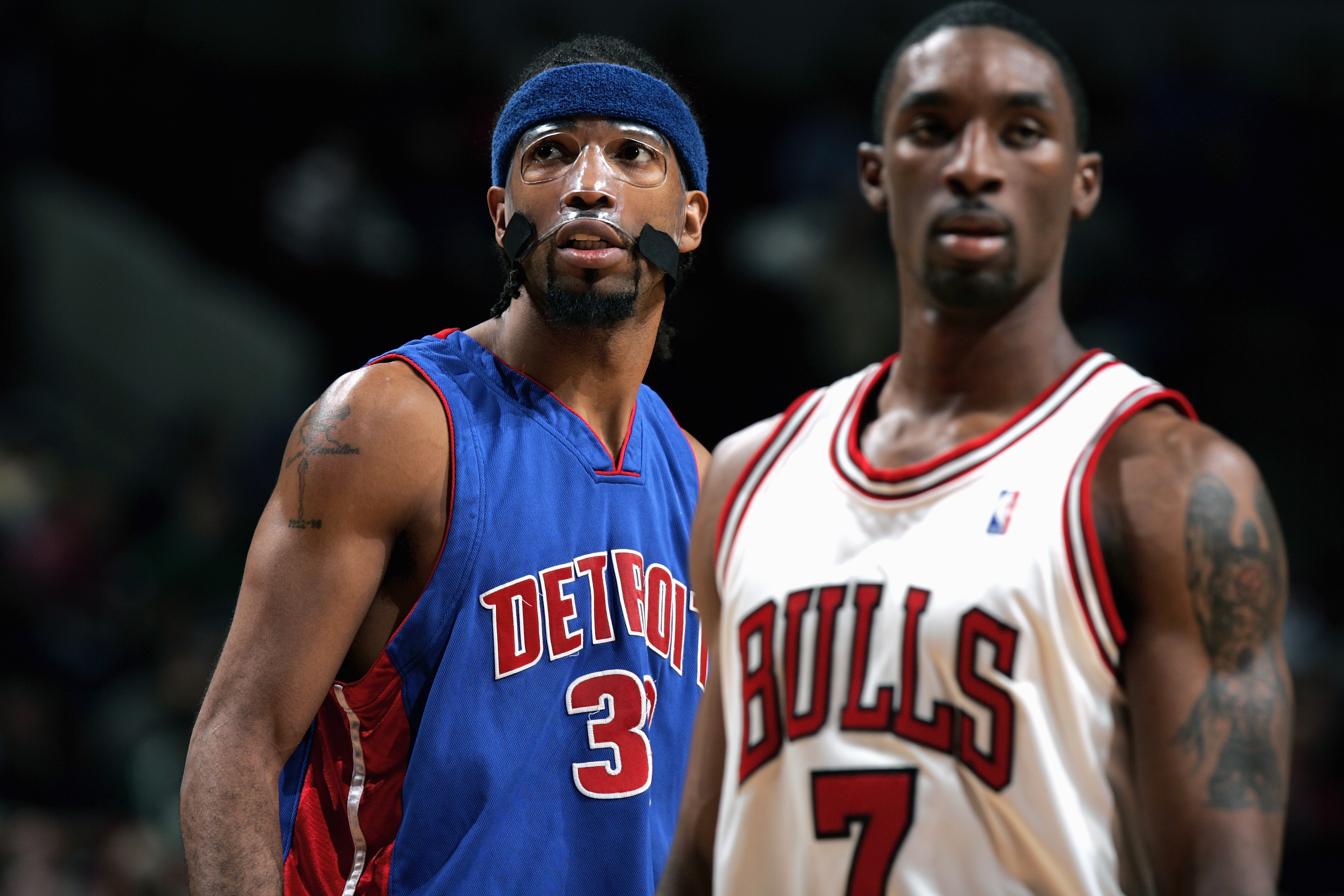 CHICAGO - JANUARY 3:  Richard Hamilton #32 of the Detroit Pistons stands on the court with Ben Gordon #7 of the Chicago Bulls during the game on January 3, 2005 at the United Center in Chicago, Illinois. The Pistons defeated the Bulls 87-80. NOTE TO USER: