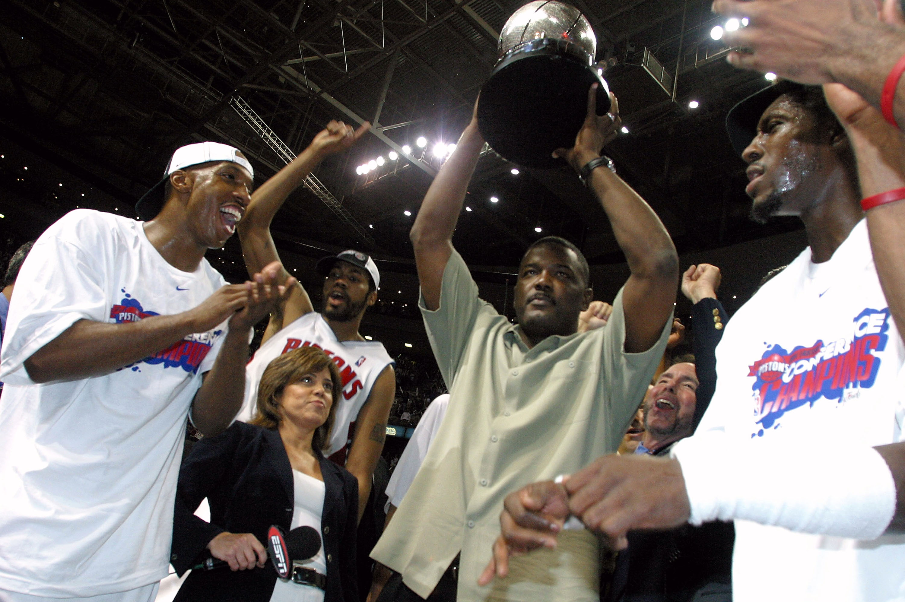 AUBURN HILLS, MI - JUNE 1:  (L-R) Chauncey Billups #1, Rasheed Wallace #30, President of Basketball Operations Joe Dumars (holding trophy) and Ben Wallace #3 of the Detroit Pistons celebrate their win over the Indiana Pacers in Game six of the Eastern Con