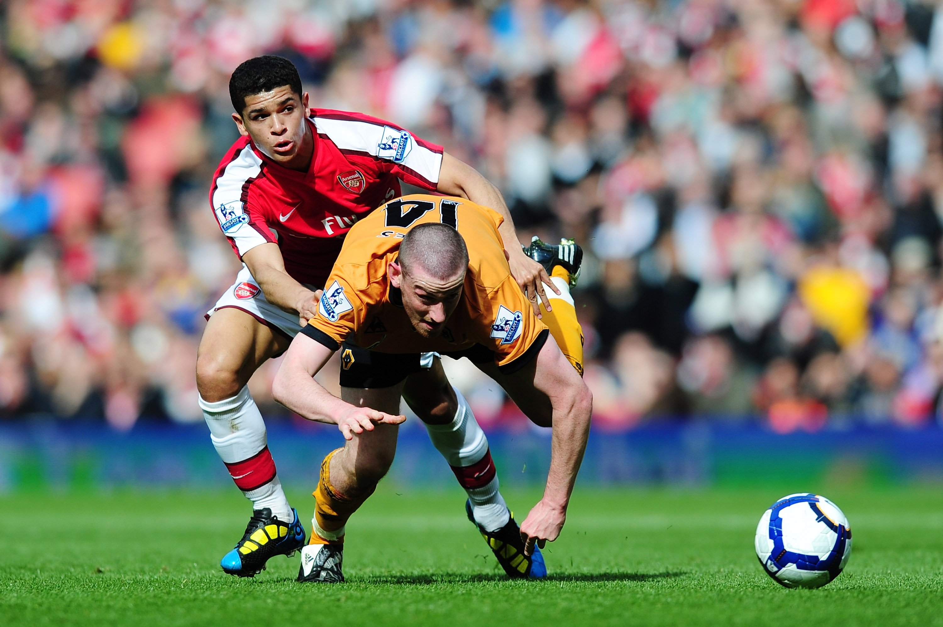 LONDON, ENGLAND - APRIL 03:  Denilson of Arsenal is challenged by David Jones of Wolverhampton Wanderers during the Barclays Premier League match between Arsenal and Wolverhampton Wanderers at the Emirates Stadium on April 3, 2010 in London, England.  (Ph