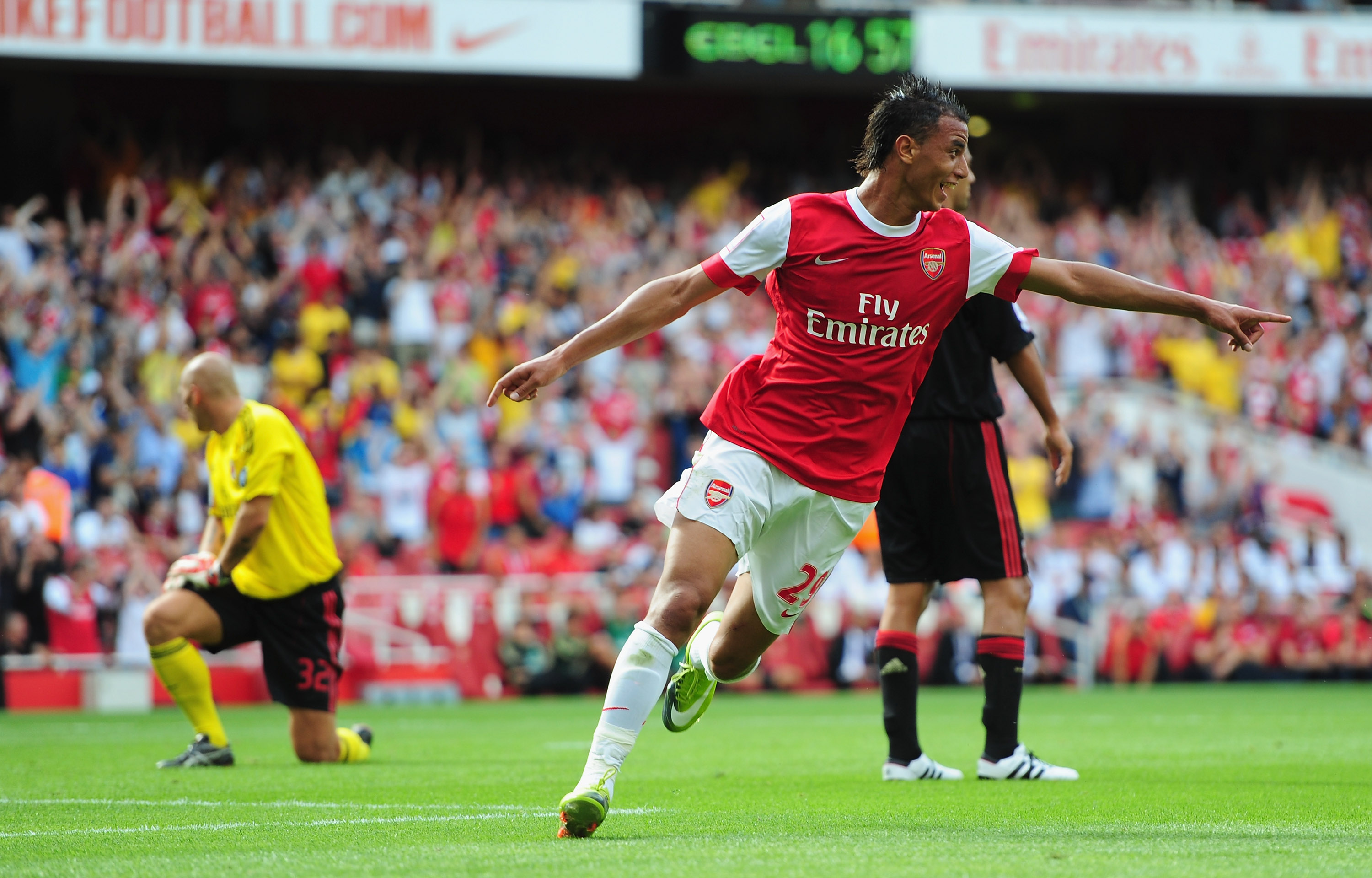 LONDON, ENGLAND - JULY 31:  Marouane Chamakh of Arsenal celebrates after scoring during the Emirates Cup match between Arsenal and AC Milan at Emirates Stadium on July 31, 2010 in London, England.  (Photo by Mike Hewitt/Getty Images)