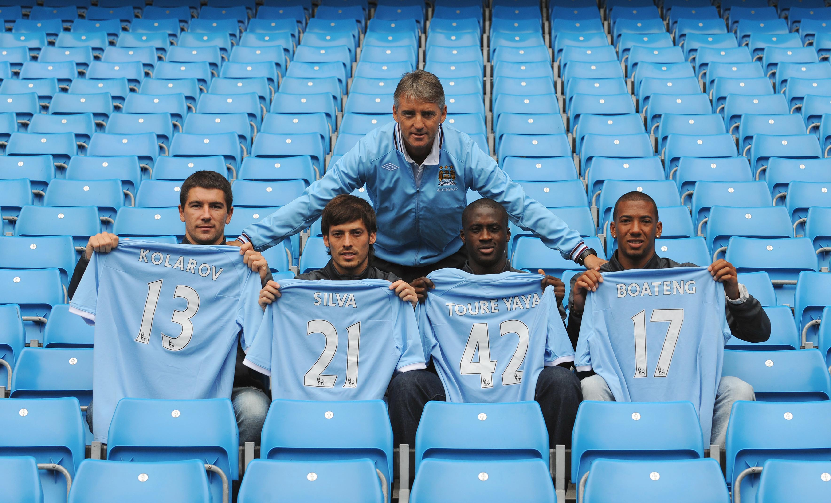 MANCHESTER, ENGLAND - AUGUST 6:  Manager Roberto Mancini (C) poses with new signings (L-R) Aleksandar Kolarov, David Silva, Yaya Toure and Jerome Boateng during a Manchester City training session at the City of Manchester Stadium on August 6, 2010 in Manc