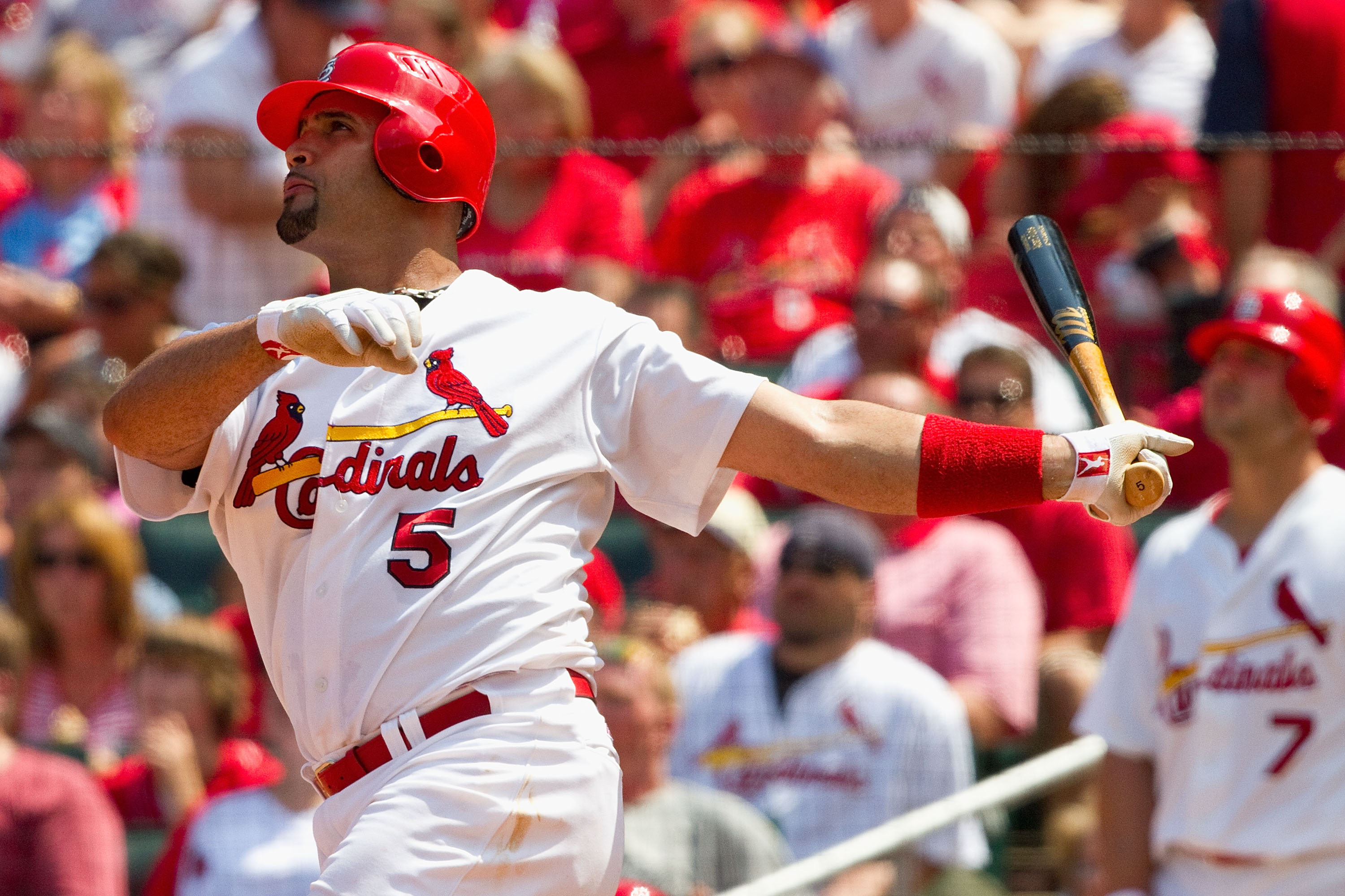 ST. LOUIS - AUGUST 1: Albert Pujols #5 of the St. Louis Cardinals hits a two-run home run against the Pittsburgh Pirates at Busch Stadium on August 1, 2010 in St. Louis, Missouri.  The Cardinals beat the Pirates 9-1.  (Photo by Dilip Vishwanat/Getty Image