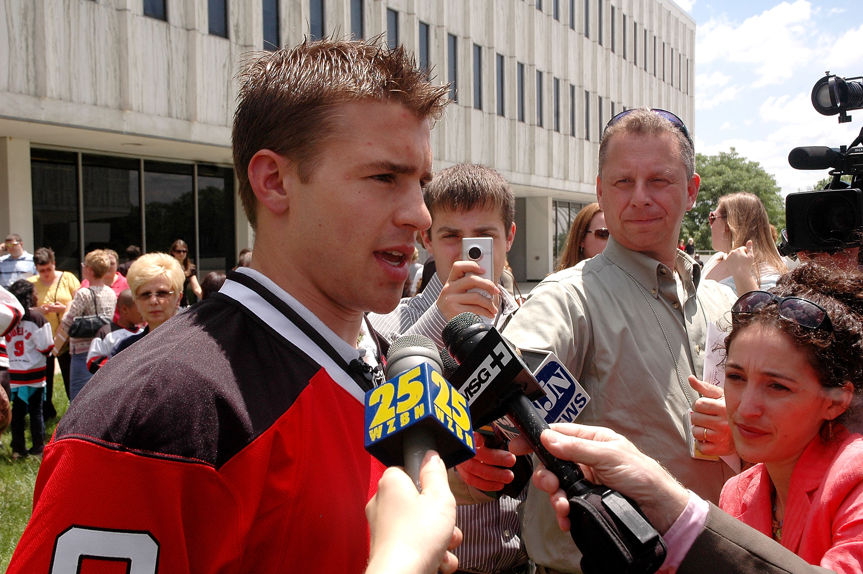 TRENTON, NJ - MAY 25: New Jersey Devils forward Zach Parise is interviewed by the media during Zach Parise Reads to Students at the State Library on May 25, 2010 in Trenton, New Jersey. (Photo by Andy Marlin/Getty Images for the New Jersey Devils)