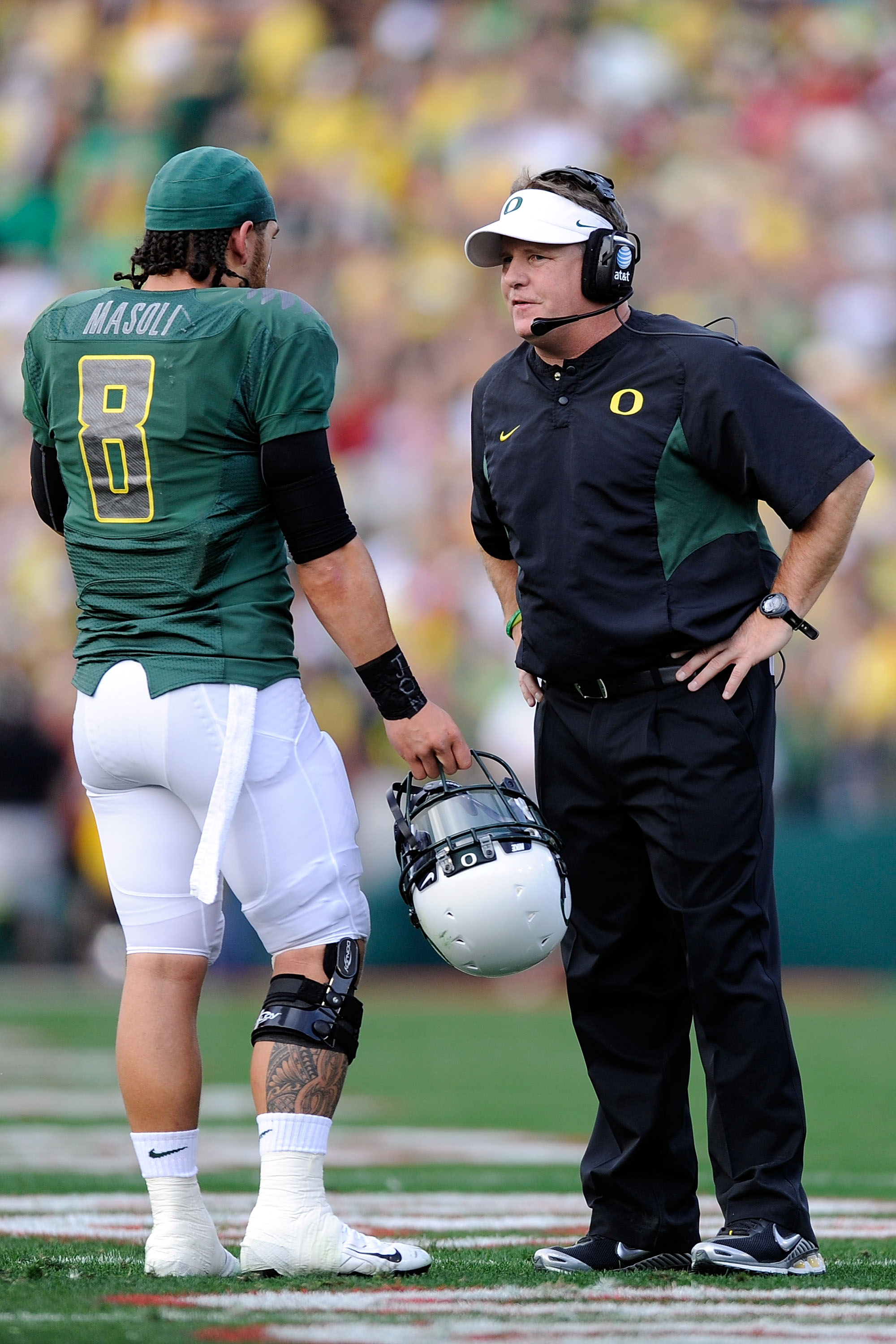 PASADENA, CA - JANUARY 01:  Head coach Chip Kelly of the Oregon Ducks talks with quarterback Jeremiah Masoli #8 during the game against the Ohio State Buckeyes at the 96th Rose Bowl game on January 1, 2010 in Pasadena, California.  (Photo by Kevork Djanse