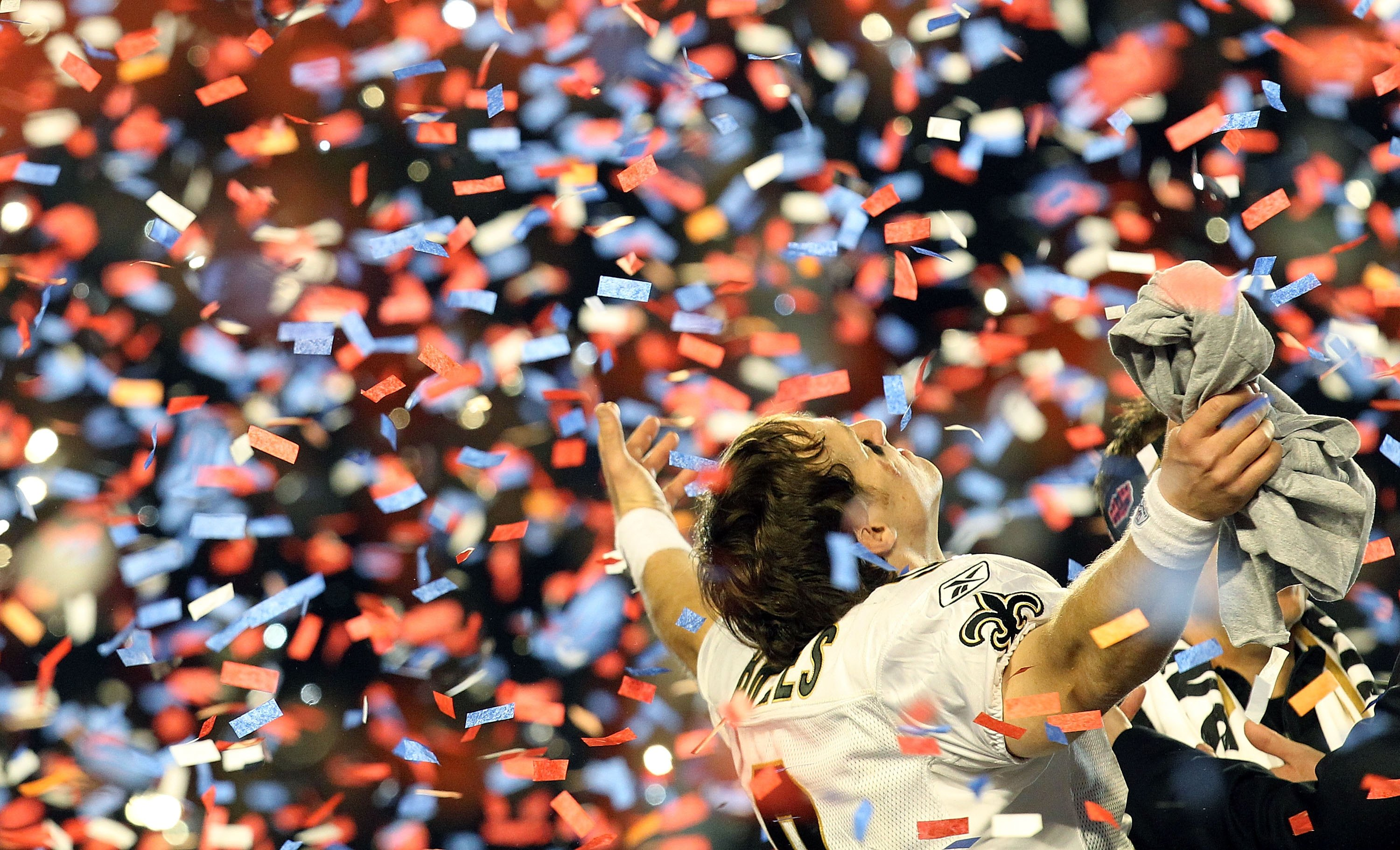 Drew Brees celebrates after the New Orleans Saints defeat the Indianapolis Colts 31-17 in Super Bowl XLIV