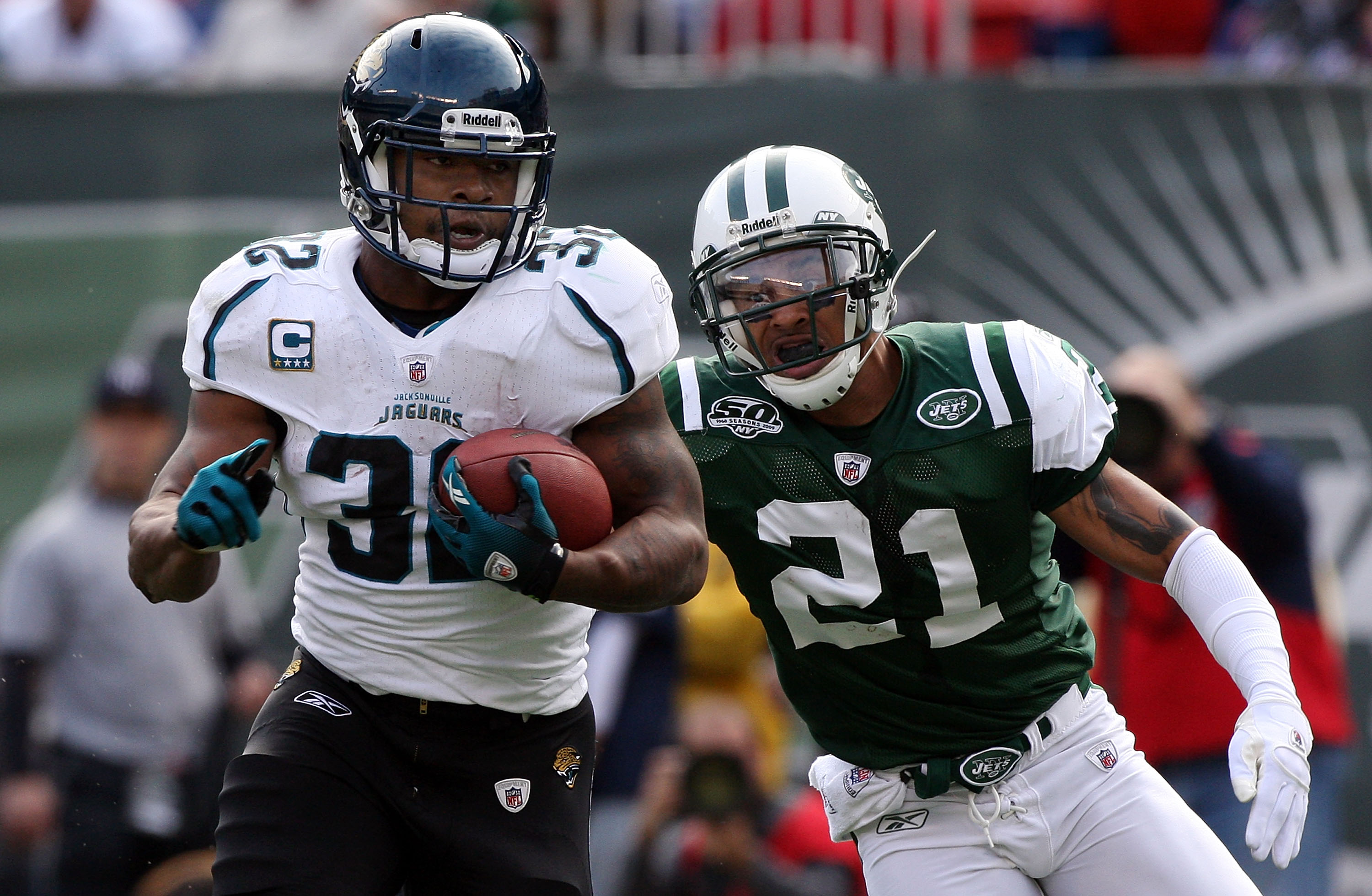 EAST RUTHERFORD, NJ - NOVEMBER 15:  Maurice Jones-Drew #32 of the Jacksonville Jaguars runs the ball past Dwight Lowery #21 of the New York Jets for a first quarter touchdown on November 15, 2009 at Giants Stadium in East Rutherford, New Jersey.  (Photo b