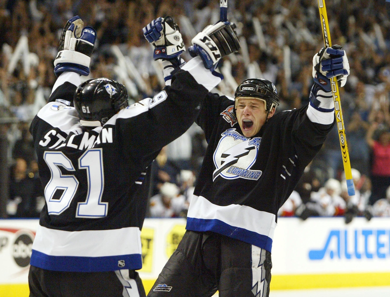 Cory Stillman and Ruslan Fedokento celebrate.