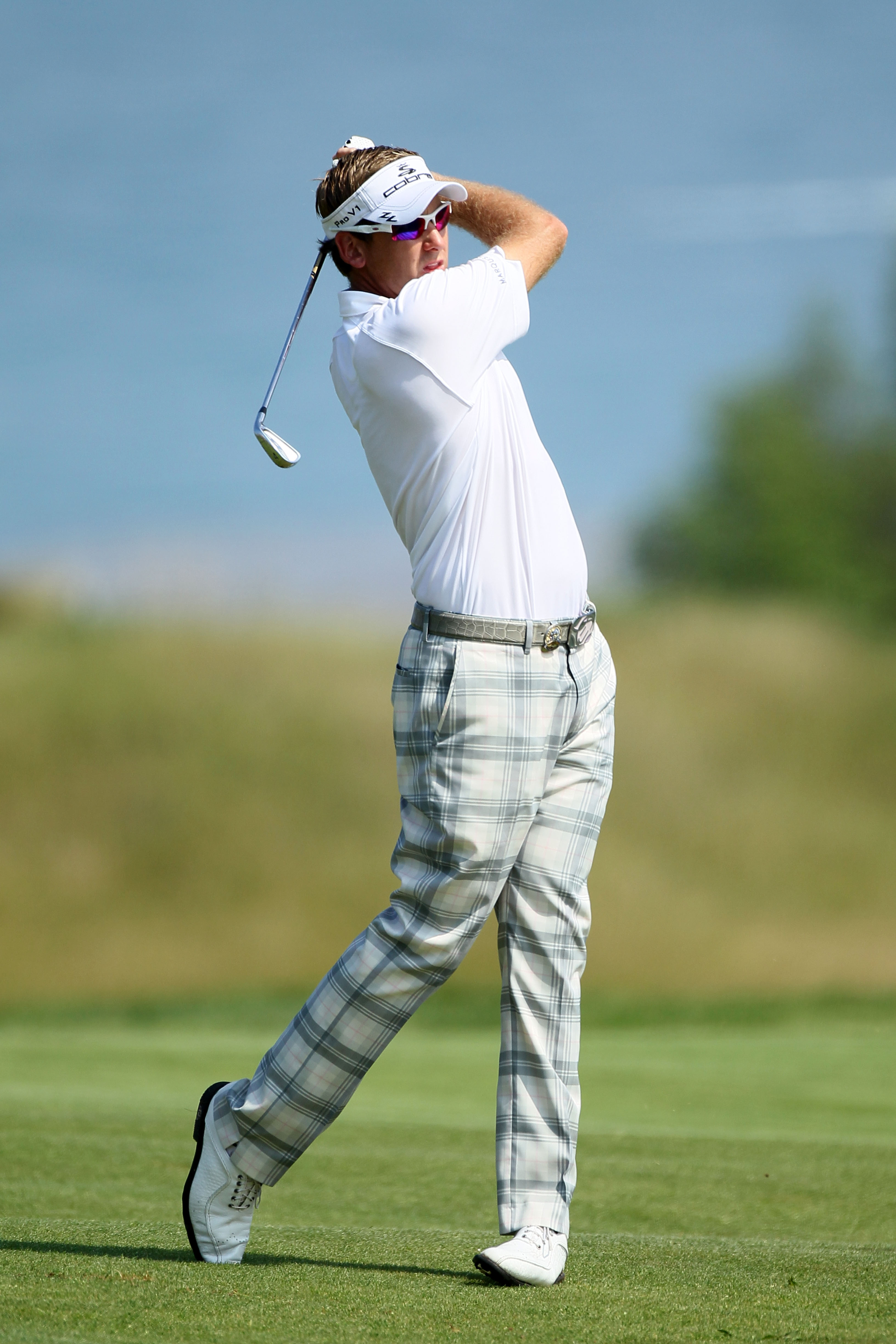 KOHLER, WI - AUGUST 11:  Ian Poulter of England hits a shot during a practice round prior to the start of the 92nd PGA Championship on the Straits Course at Whistling Straits on August 11, 2010 in Kohler, Wisconsin.  (Photo by Andy Lyons/Getty Images)