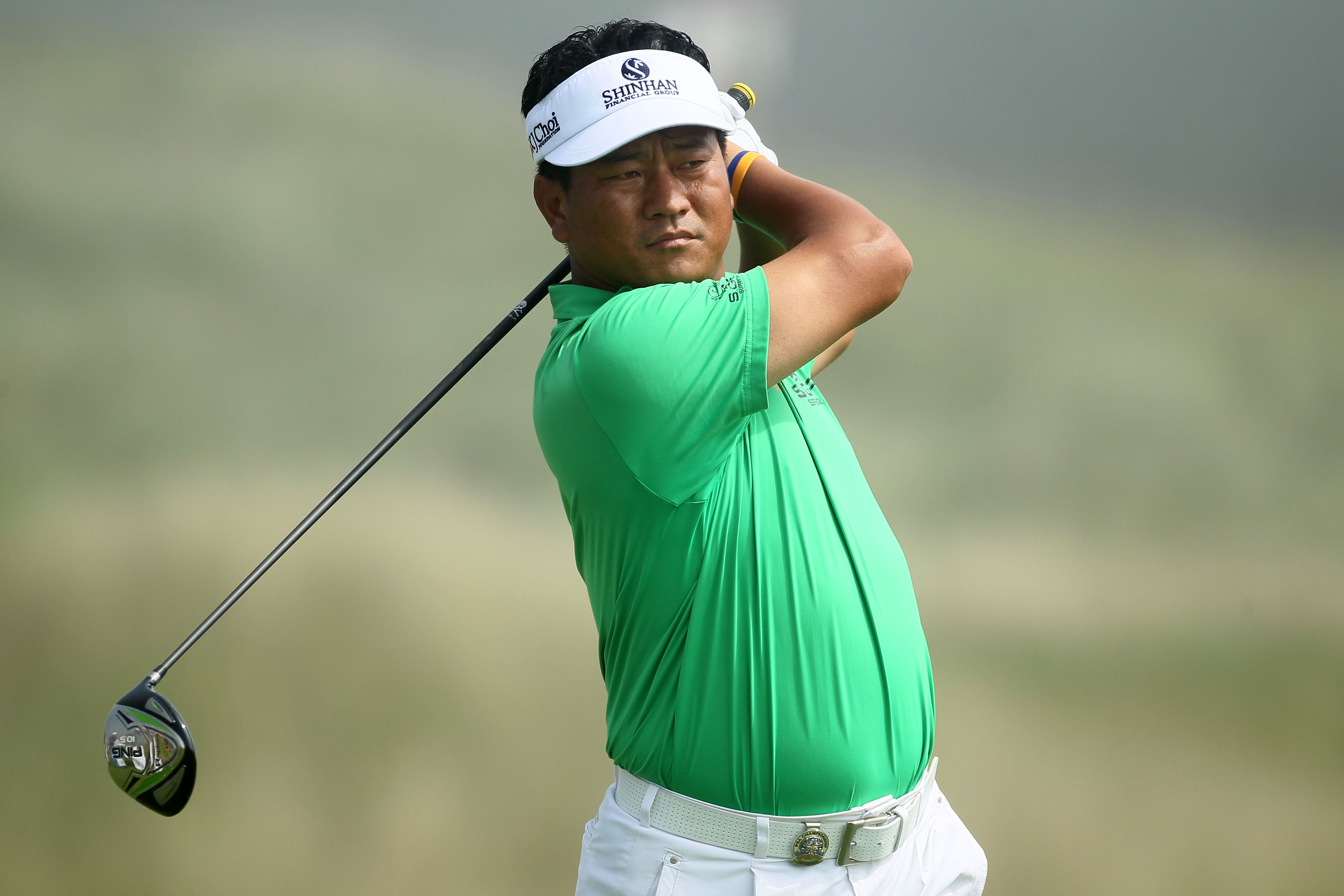 KOHLER, WI - AUGUST 12:  K.J. Choi of South Korea watches his tee shot on the second hole during the first round of the 92nd PGA Championship on the Straits Course at Whistling Straits on August 12, 2010 in Kohler, Wisconsin.  (Photo by Andy Lyons/Getty I